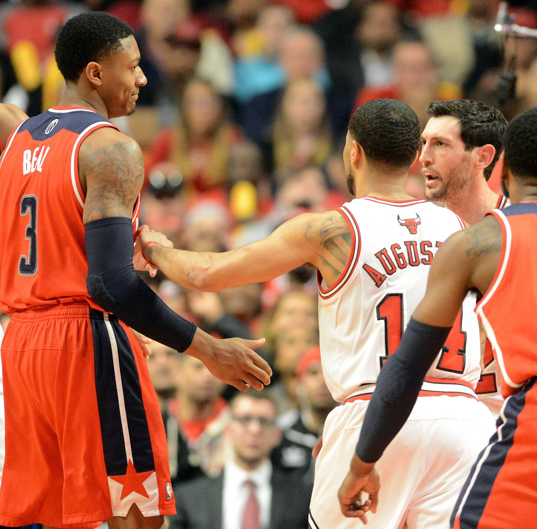 Washington Wizards guard Bradley Beal (3) and Chicago Bulls guard Kirk Hinrich (12) get into a tussle in the second quarter.