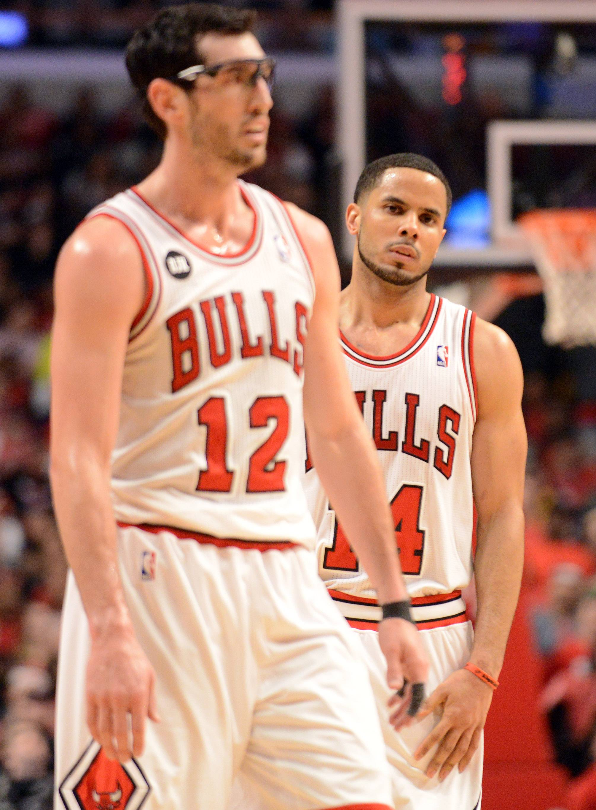 Chicago Bulls guards Kirk Hinrich (12) and D.J. Augustin (14) walk back upcourt as the game slips away in overtime .