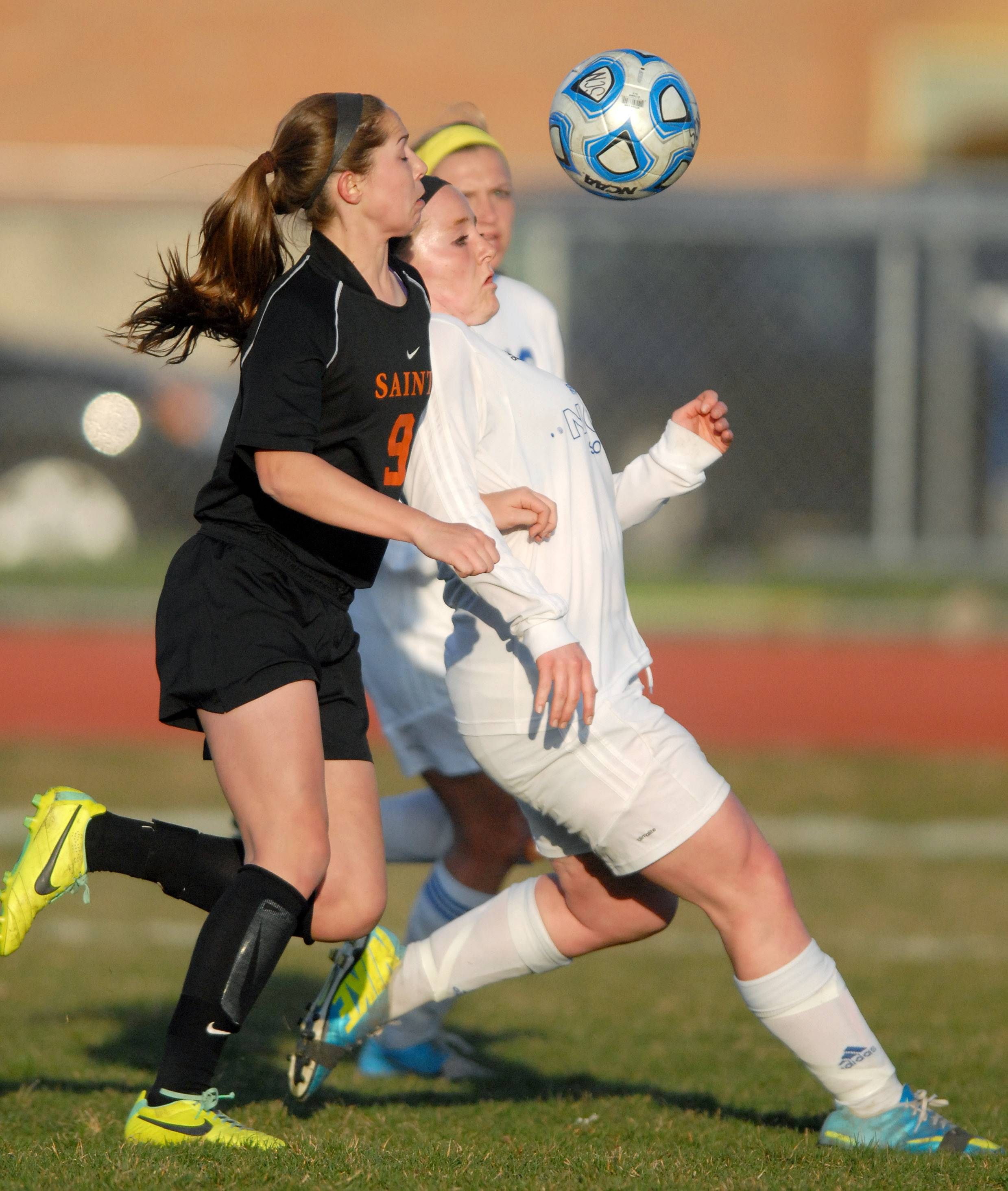 St. Charles East's Darcy Cunningham, left, and St. Charles North's Megan O'Leary fight for the ball in the first half on Tuesday, April 22.