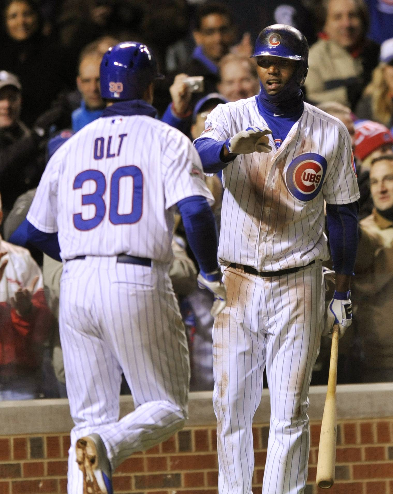 The Cubs' Junior Lake, right, greets Mike Olt after Olt hit a 3-run homer in the fifth inning Tuesday at Wrigley Field.
