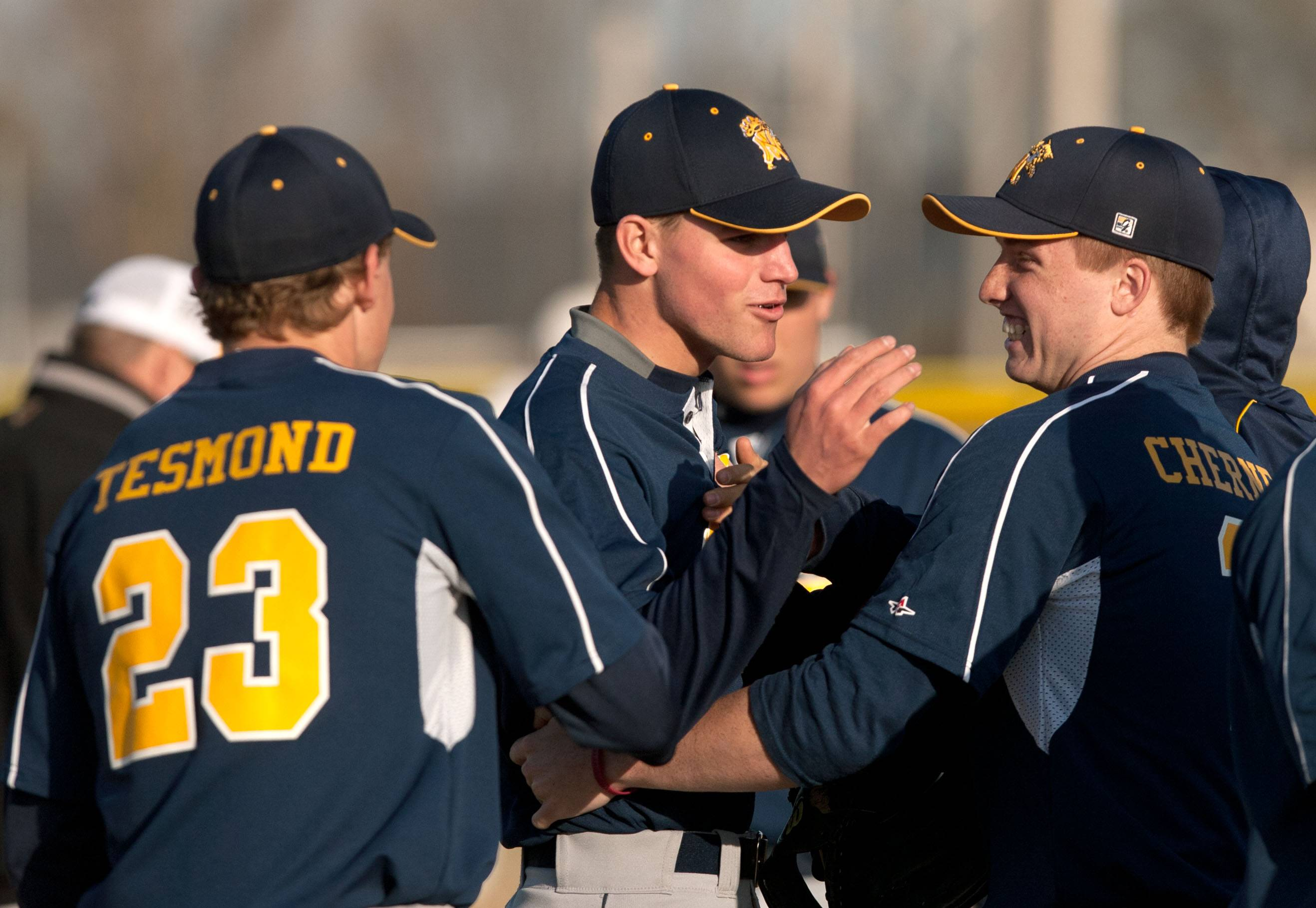 Daniel White/dwhite@dailyherald.comNeuqua Valley pitcher Andy Sommers, center, celebrates a complete game 3-1 win over Metea Valley during boys baseball action in Aurora. Tyler Tesmond, left, and Evan Cherney, right, congratulate Sommers.