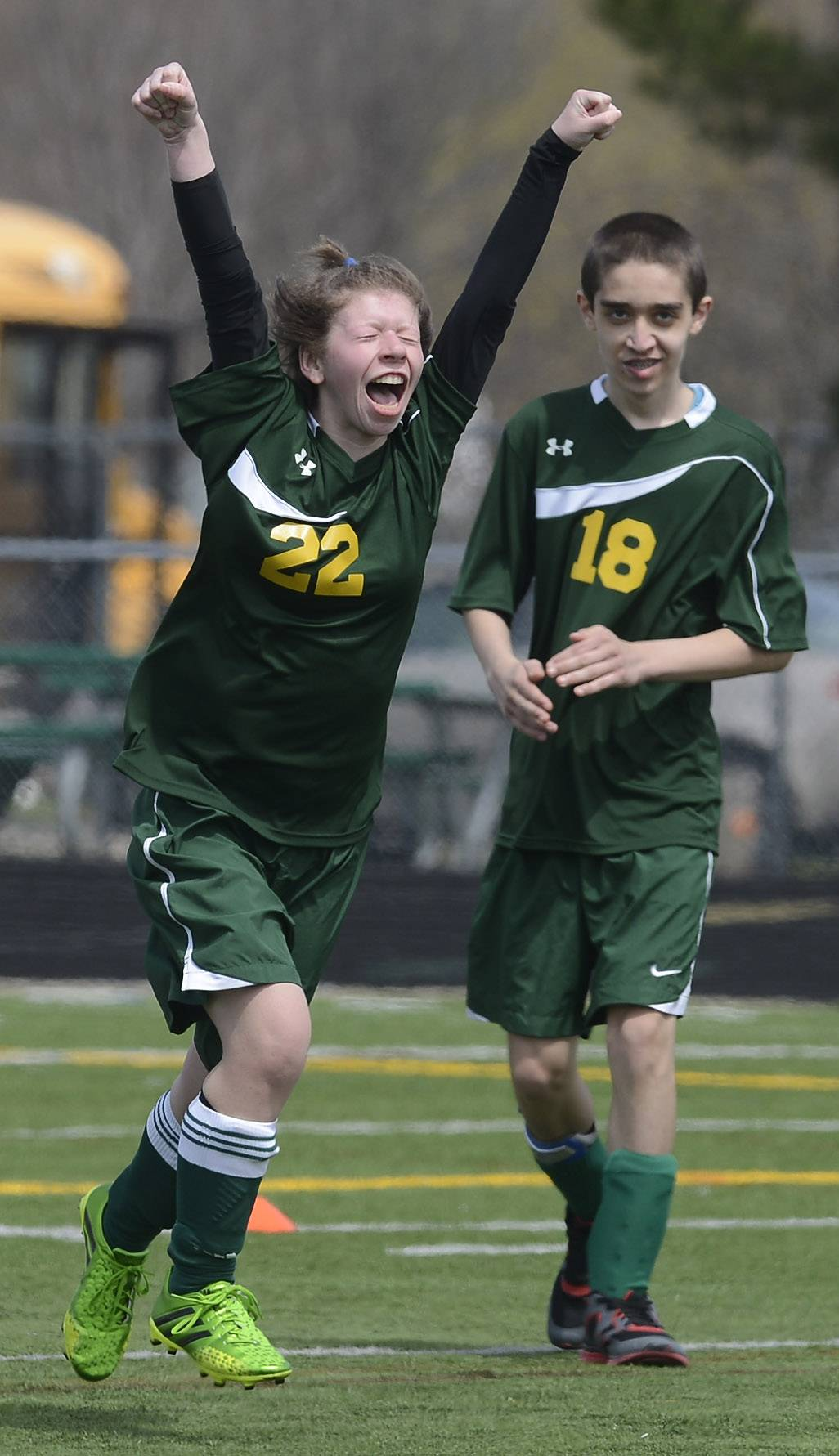 Stevenson's Jennifer Callen celebrates her goal as teammate Daniel Kahn cheers her on during Saturday's Allied Soccer Match against Mundelein in Lincolnshire.