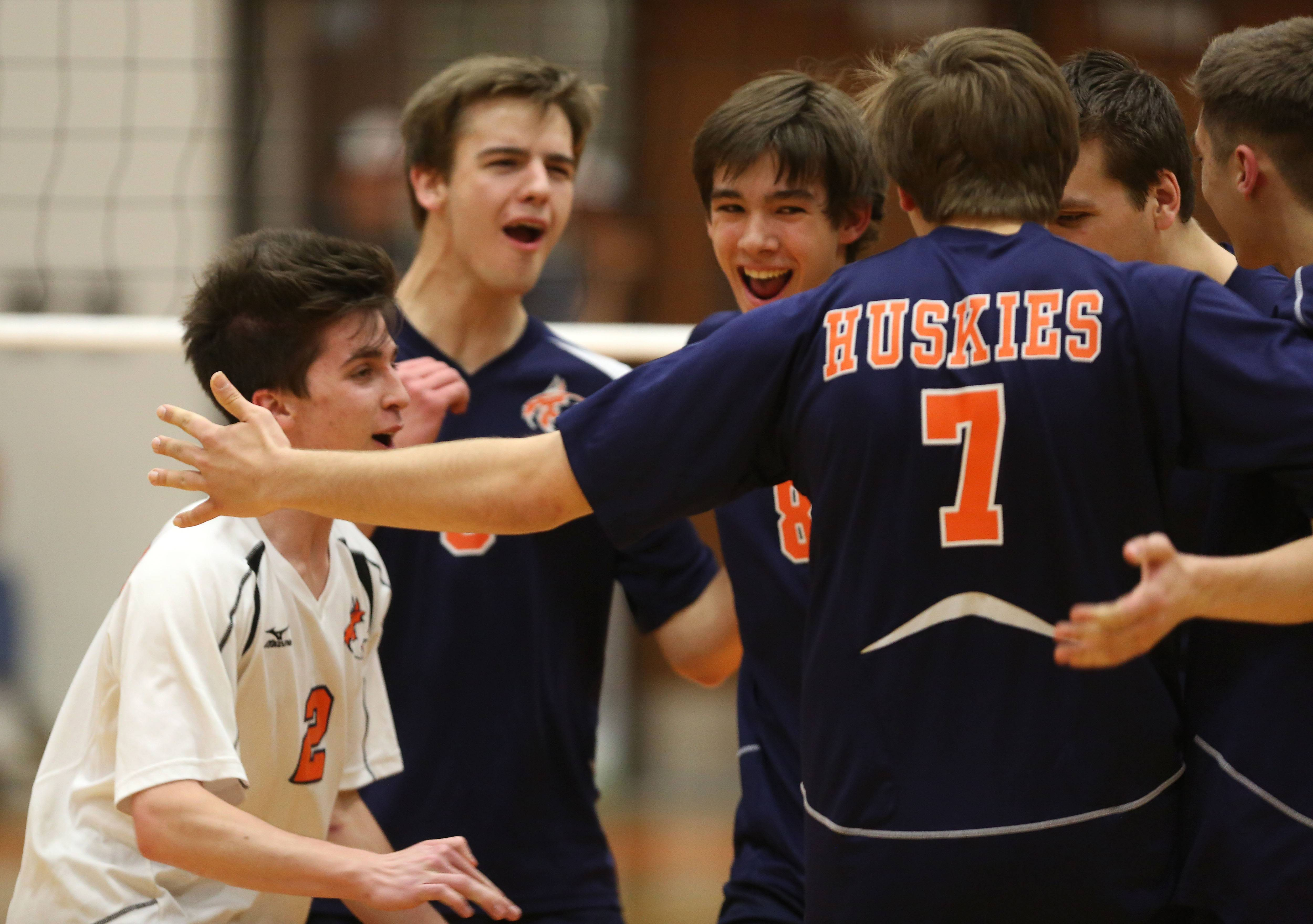 Naperville North's Will Littell, left, celebrates a point against Wheaton Warrenville South.