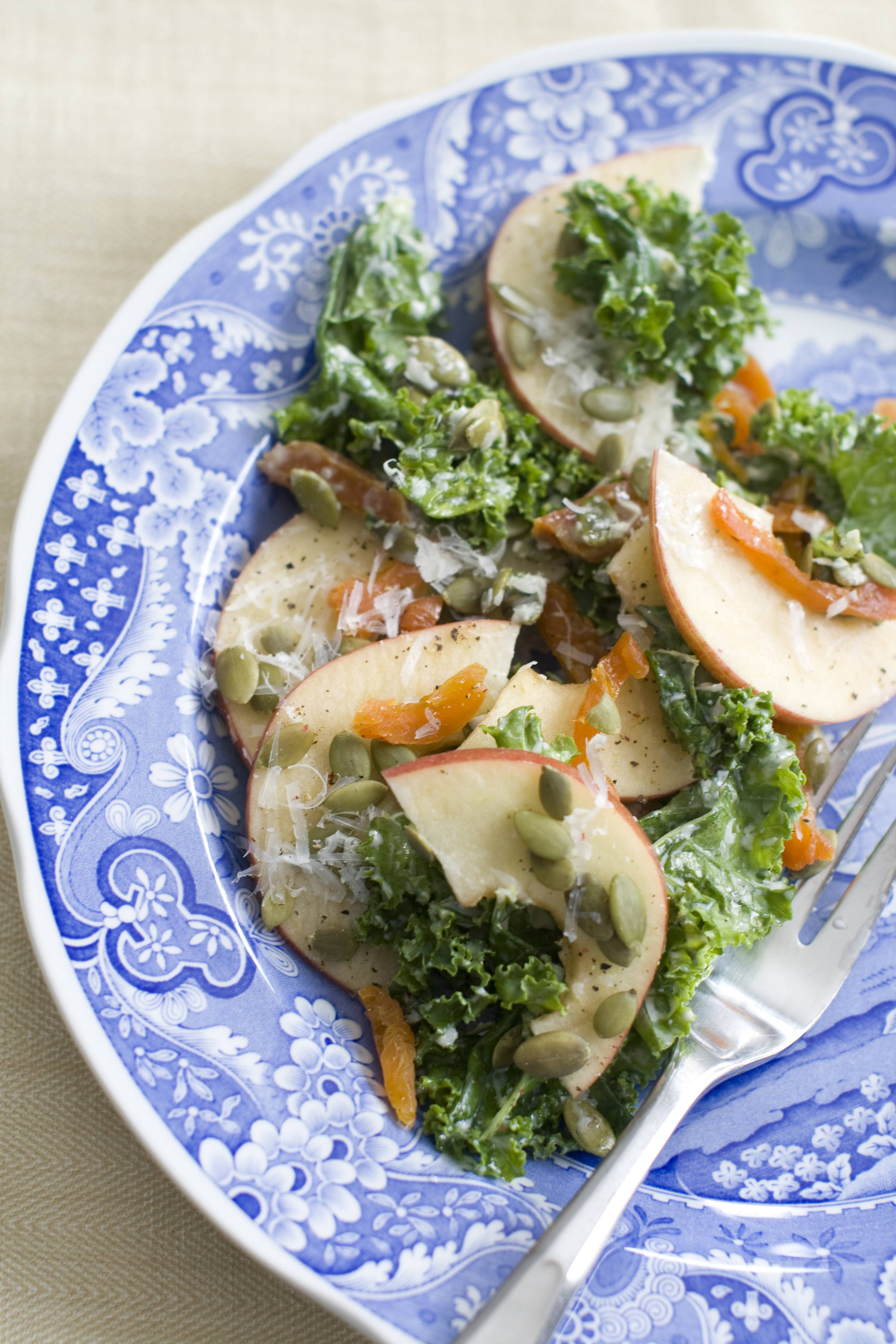Kale salad gets a boost from apricots and manchego cheese.