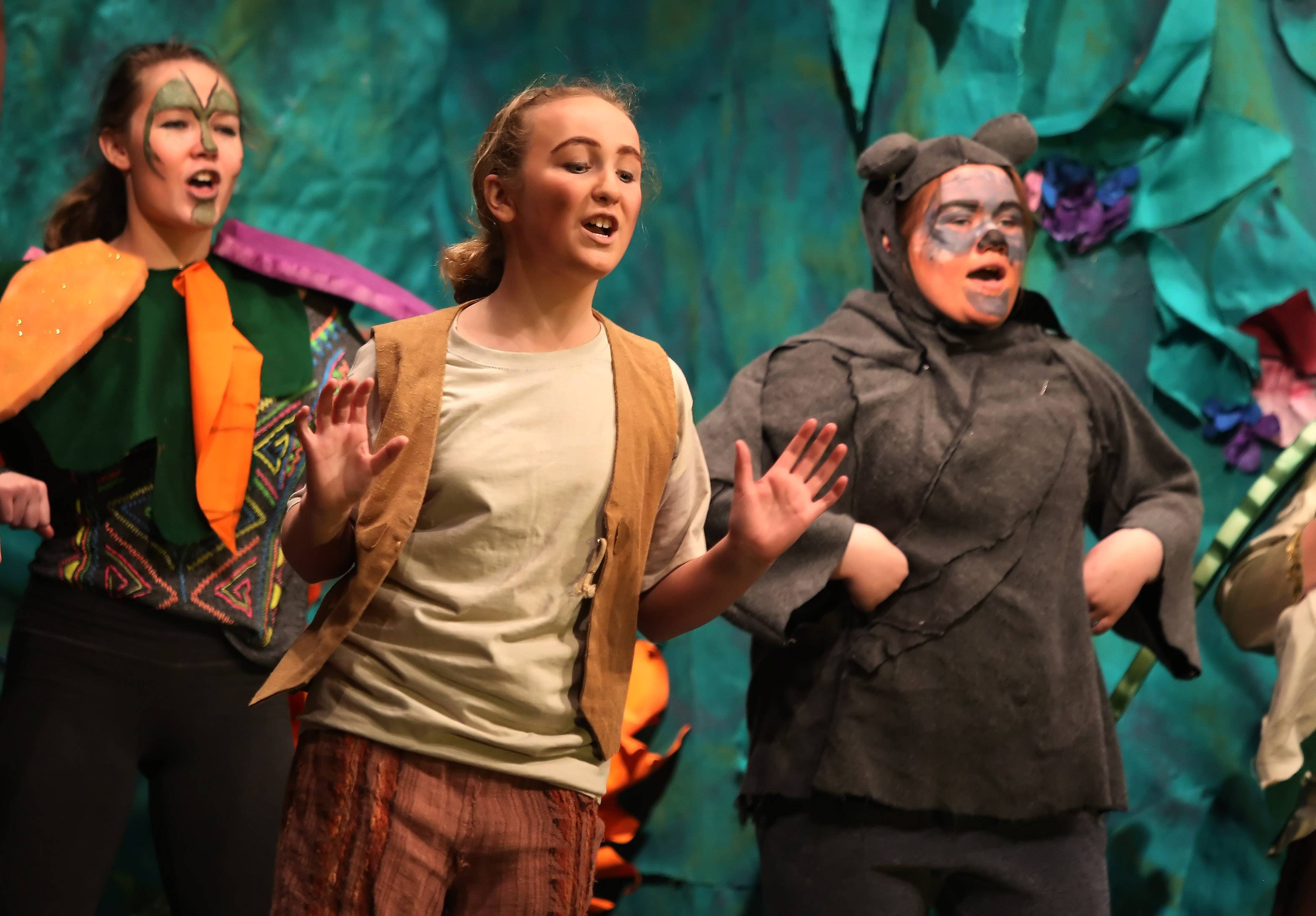 "Jenny Rudd plays Mowgli, center, and Emily Hueckstaedt plays Baloo the Bear, as Wauconda Middle School students performed ""Disney's Jungle Book Kids"" Wednesday at the school. The play will be presented for the public Thursday through Saturday at 7 p.m. in the gymnasium."