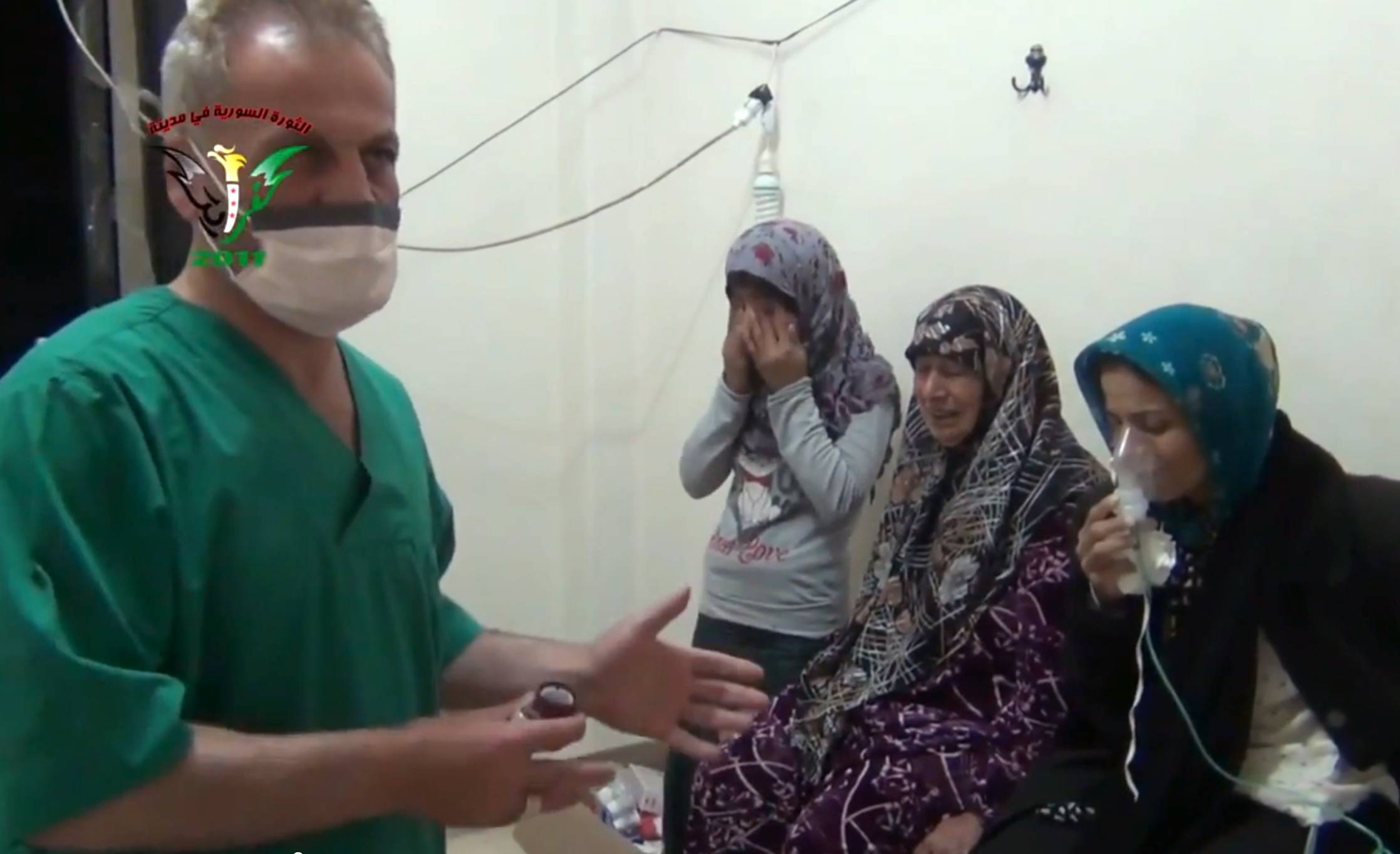 In this image taken from video, two women and a young girl are treated by a medic in Kfar Zeita, a rebel-held village in Hama province some 200 kilometers (125 miles) north of Damascus. Syrian opposition activists and other witnesses tell The Associated Press that Syrian government forces have attacked rebel-held areas with poisonous chlorine gas in recent months.