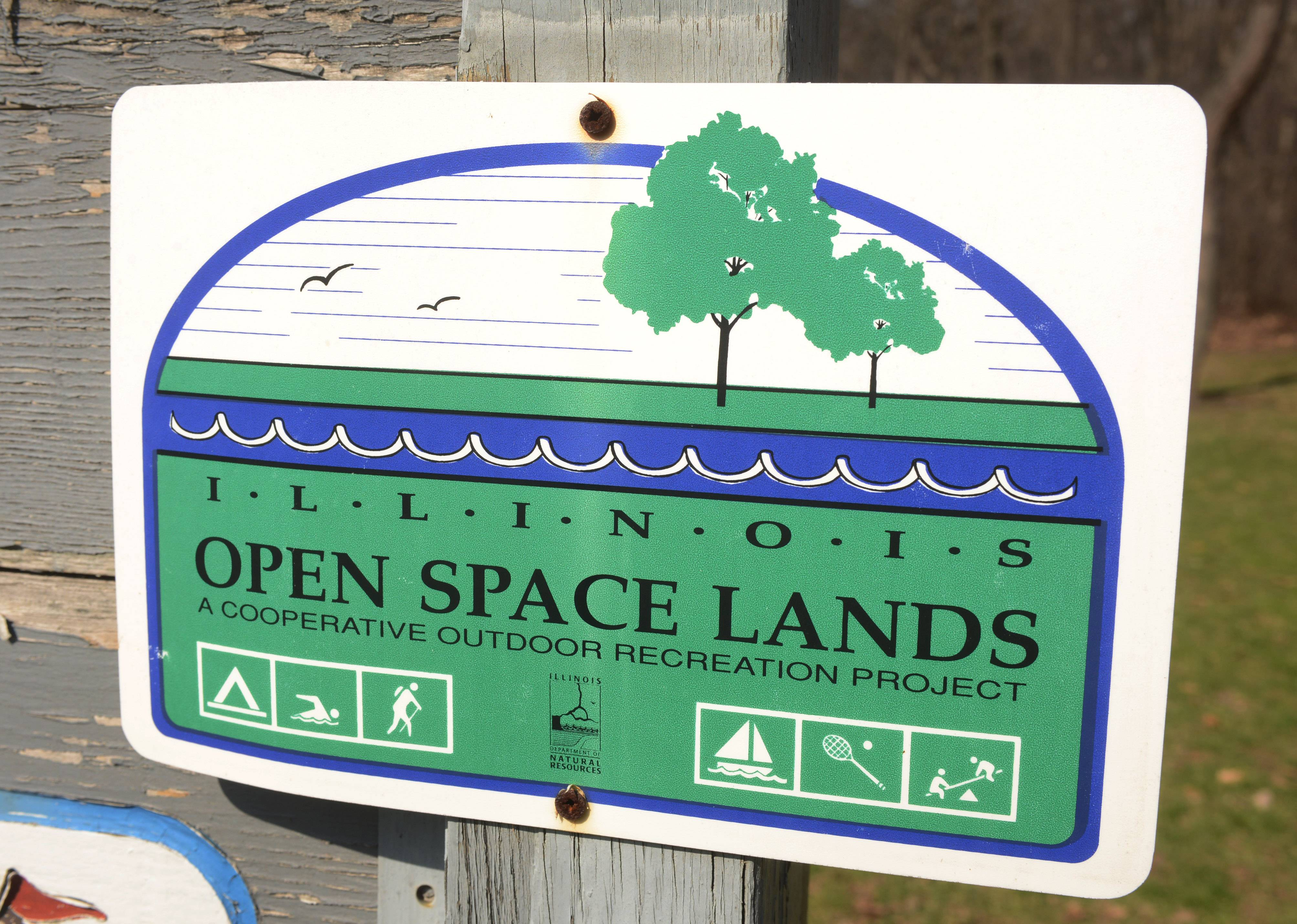 An Illinois Open Space Lands sign at Greenleaf Woods Park in Island Lake.