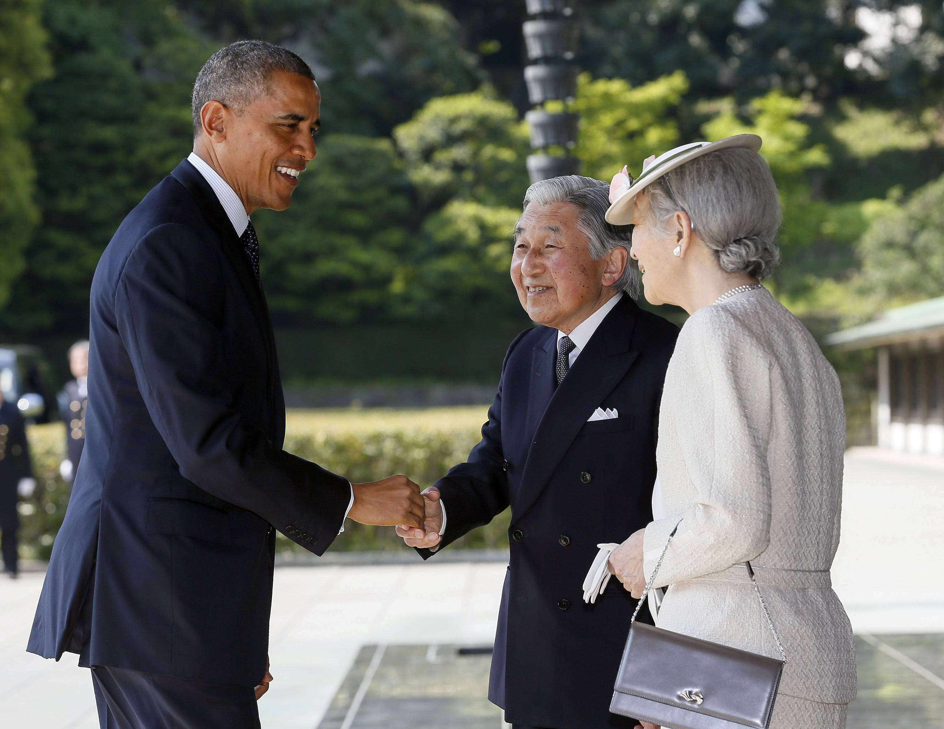 ASSOCIATED PRESS President Barack Obama is welcomed by Japan's Emperor Akihito and Empress Michiko upon his arrival at the Imperial Palace for the welcoming ceremony in Tokyo earlier today.