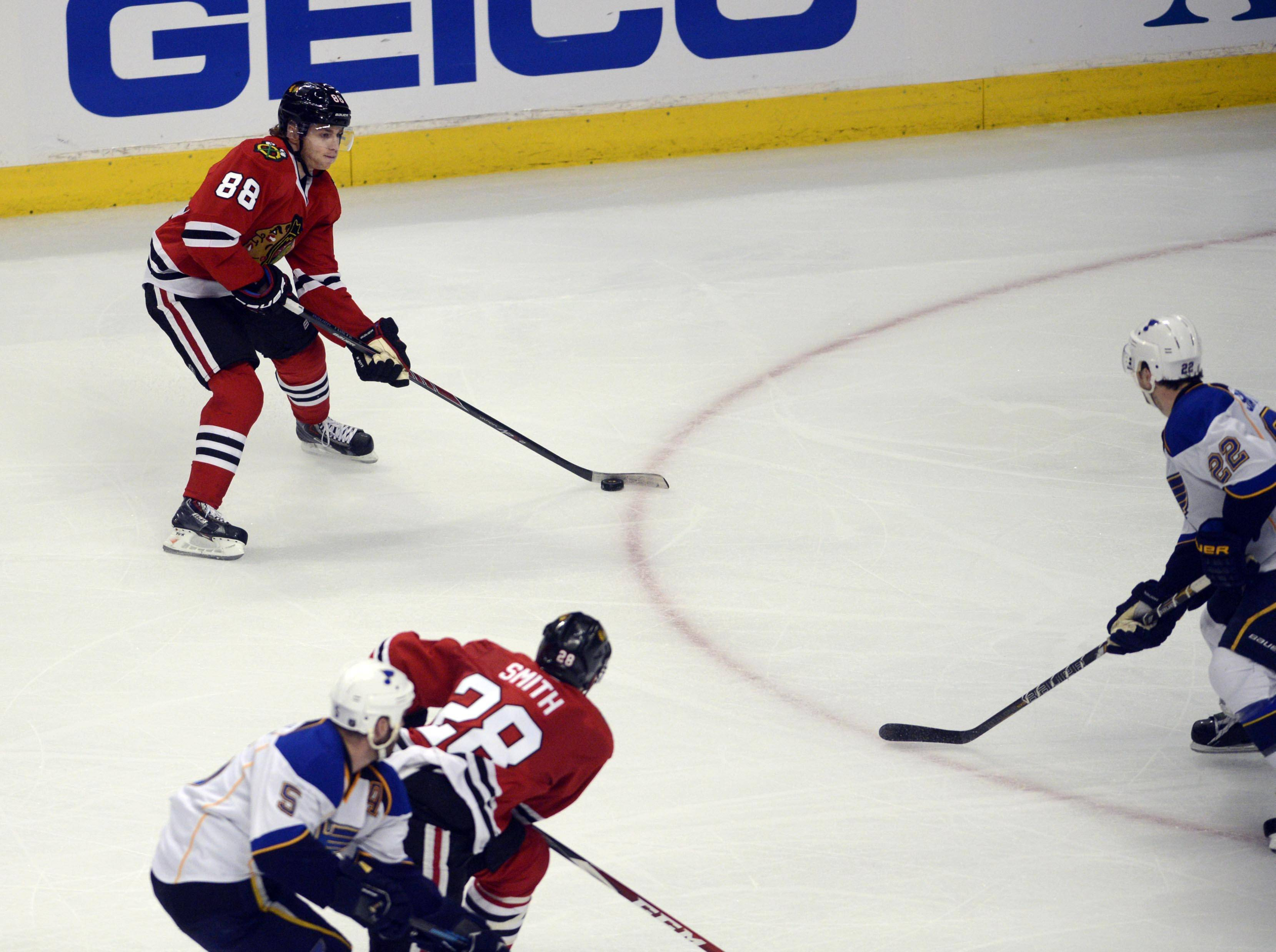 Blackhawks right wing Patrick Kane lines up his game-winning goal against the Blues in overtime of Game 4 late Wednesday at the United Center. Their first-round playoff series returns to St. Louis knotted at 2-2.