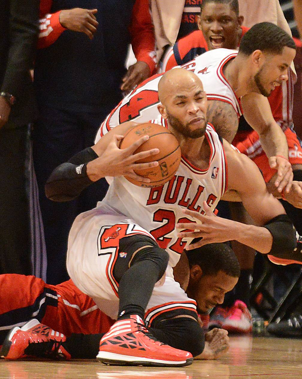 The Bulls' Taj Gibson (22) said that he called timeout three times after he went to the ground in a scramble for the ball in Tuesday's game. The official ruled it was a jump ball, which the Bulls lost.