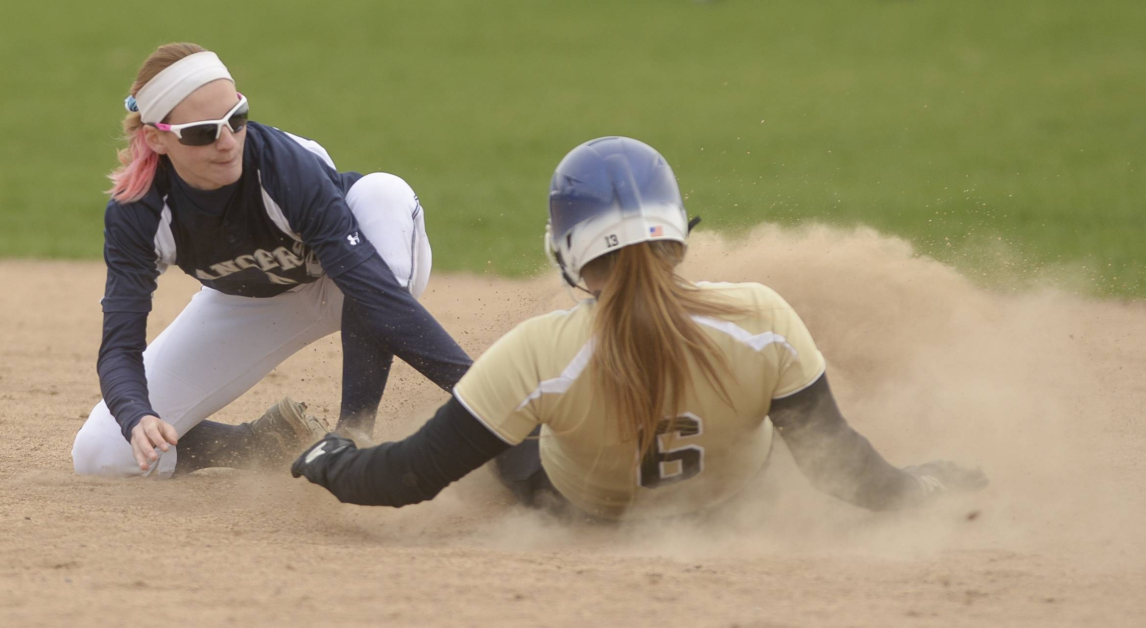 Mark Black/mblack@dailyherald.com Lake Park's Elisabeth Brown comes up short with the tag on Glenbard North's Cece Dopart during Glenbard's 8-1 win Wednesday.
