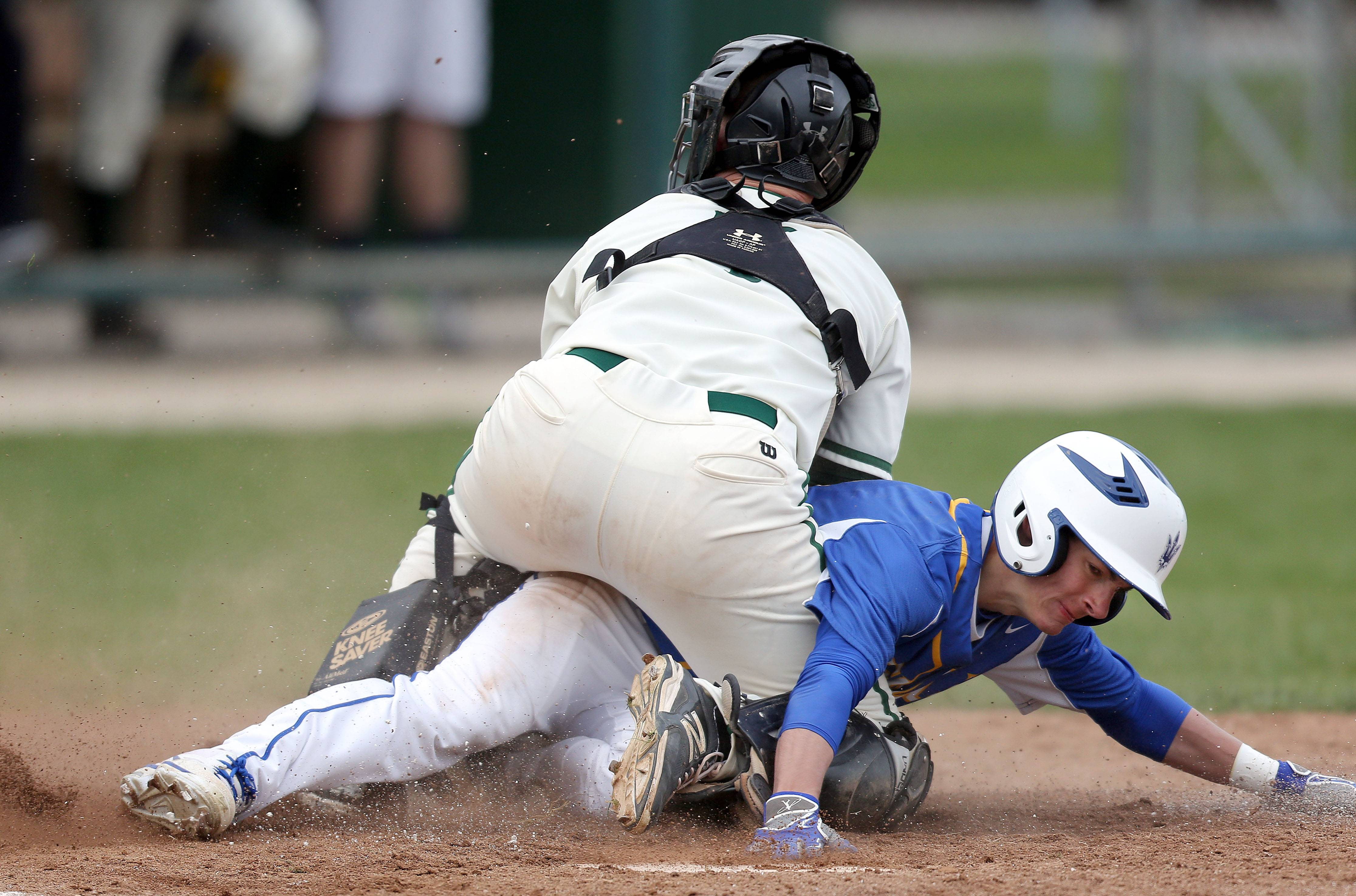 Stevenson catcher Joey Morris, left, tags out Warren's Brad Zahn at home plate Wednesday at Stevenson.