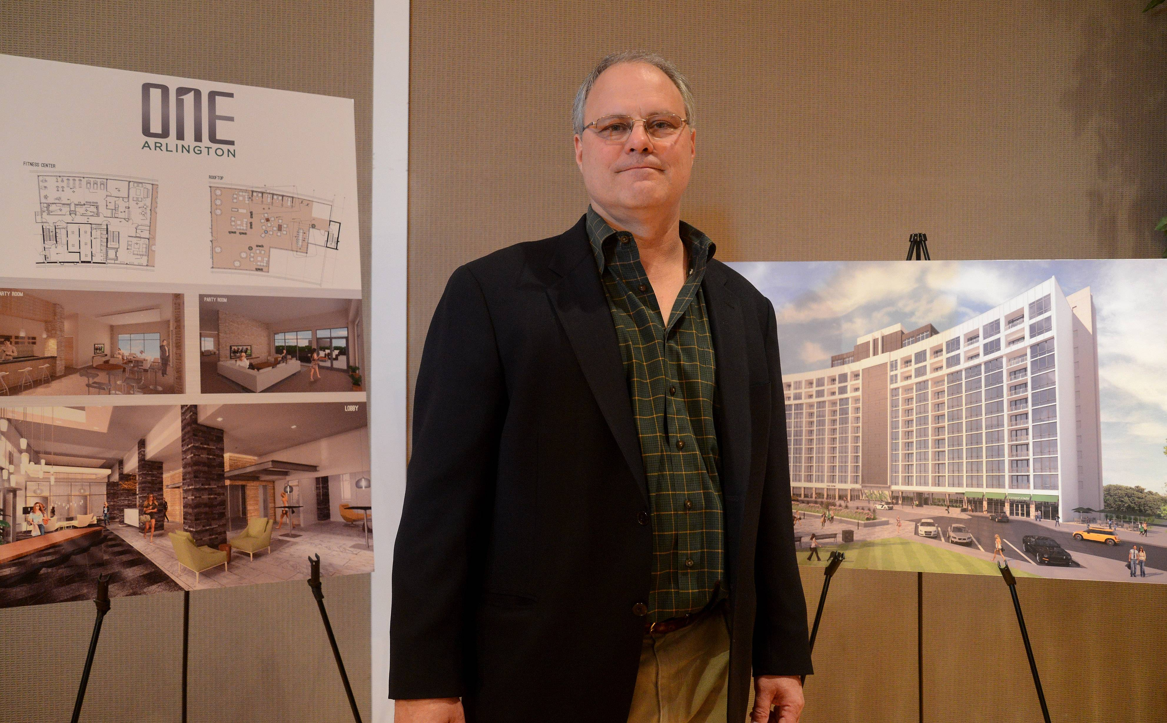 Rich Cavenaugh, president of Stoneleigh Companies, stands in front of mock-ups of the Arlington Downs project.