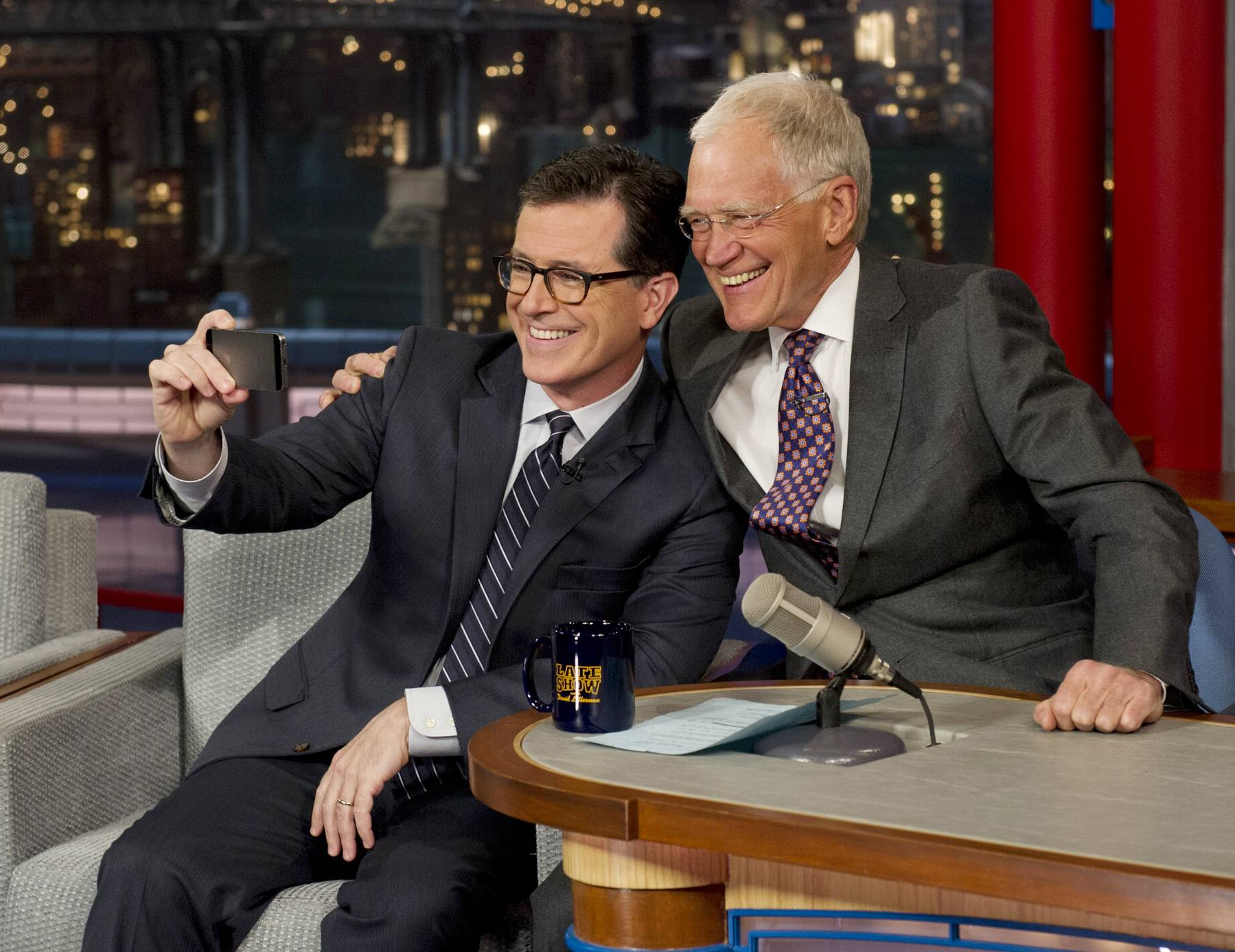 "Comedy Central's Stephen Colbert takes a selfie with host David Letterman on the set of the ""Late Show With David Letterman"" Tuesday in New York. This was Colbert's first visit to the show since CBS announced that he will succeed Letterman as host when he retires in 2015."