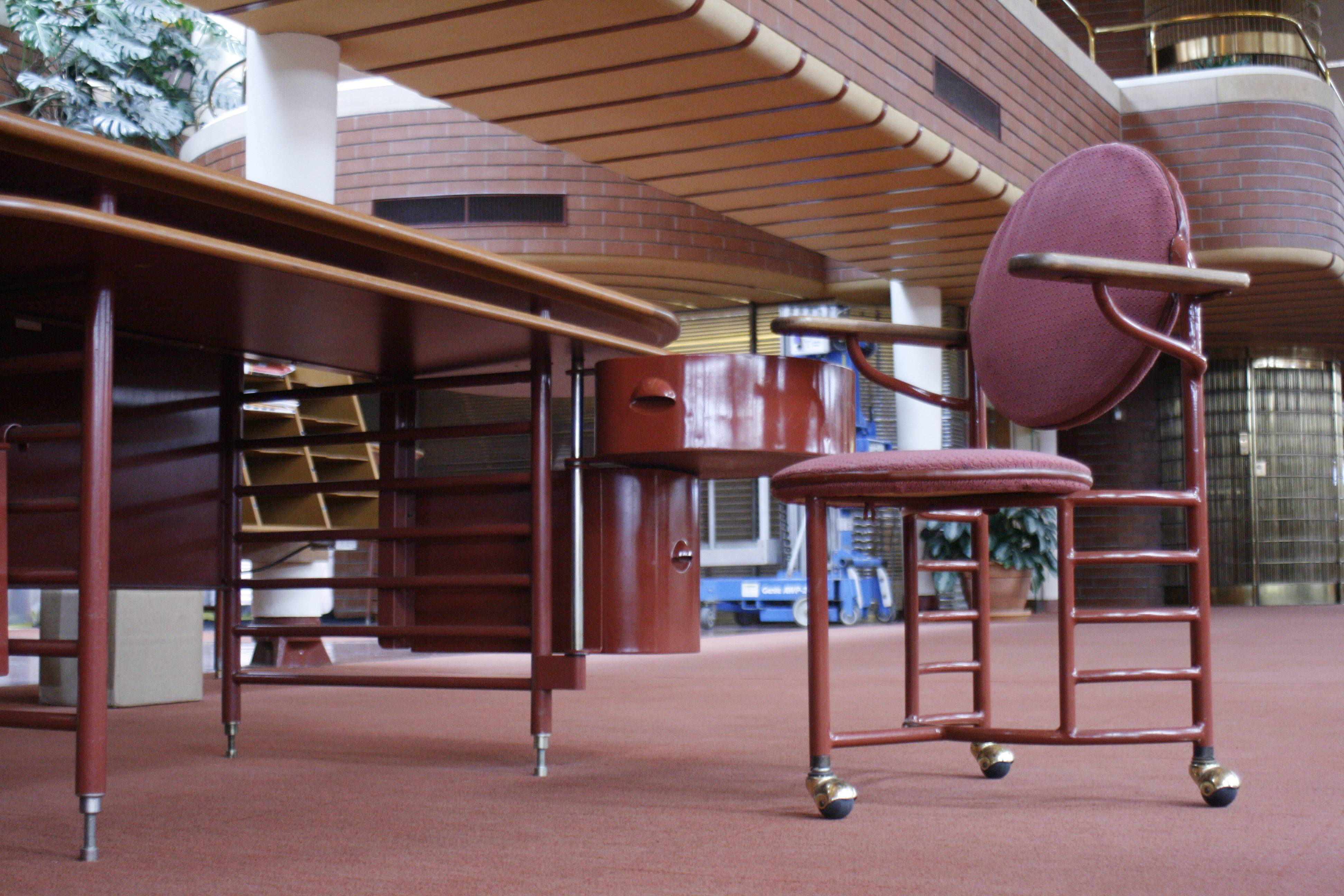 On the tour, visitors can see an original desk and a three-legged chair designed by architect Frank Lloyd Wright for workers at the SC Johnson Administration Building in Racine, Wis. Most employees' chairs were later modified to have four legs because employees kept tipping over.