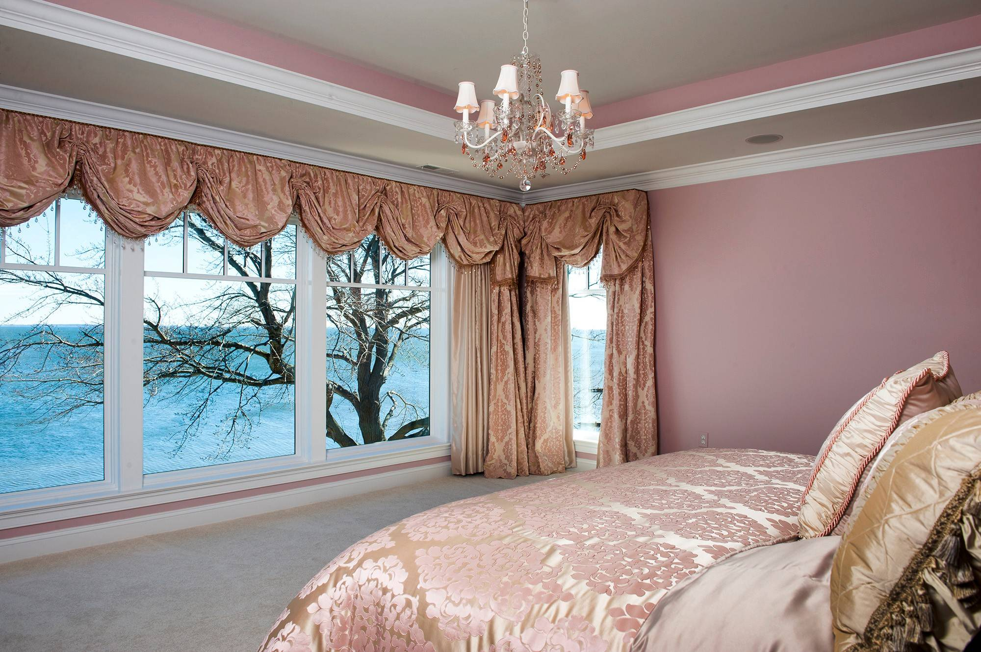 The McSweeny's master bedroom has ample room to maneuver a wheelchair if needed in the future; floor to ceiling windows bring in natural light and offer sweeping views of the Chesapeake Bay.