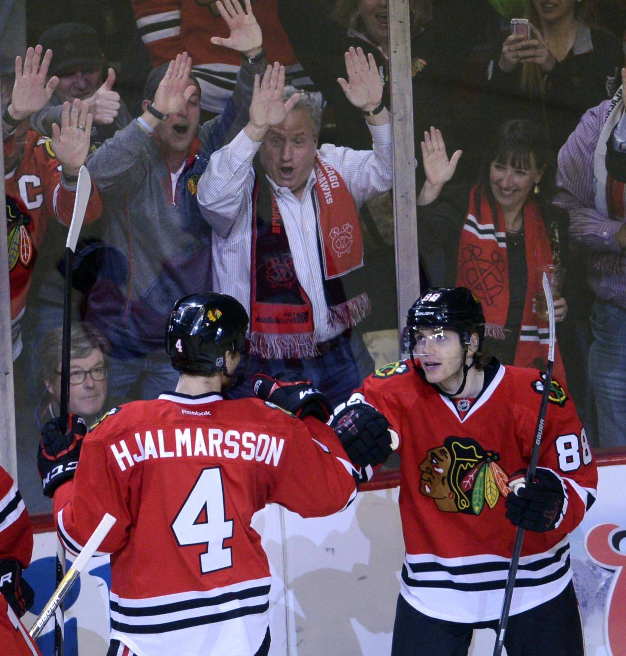 The crowd celebrates a second-period goal by Chicago Blackhawks right wing Patrick Kane.