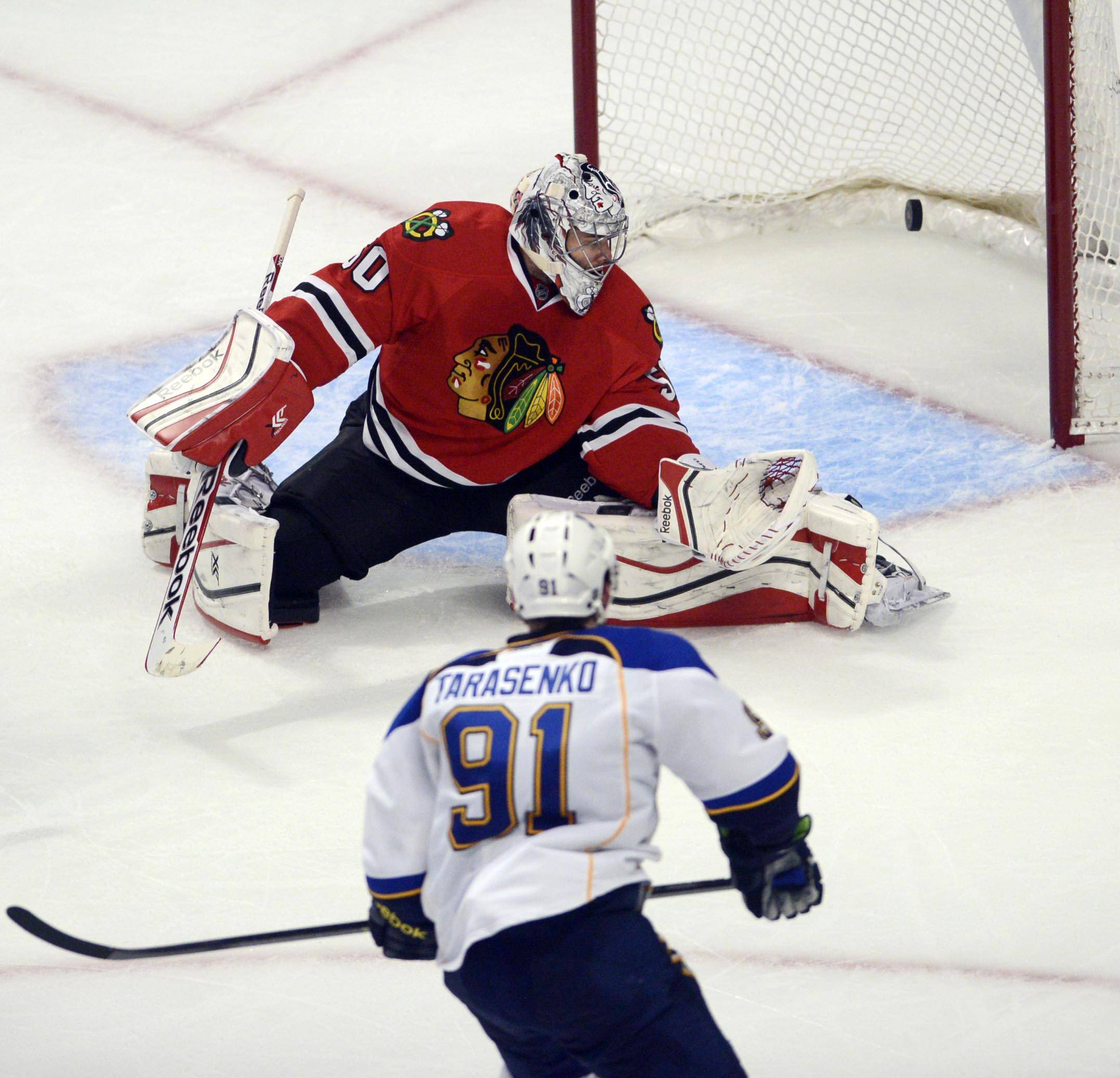St. Louis Blues right wing Vladimir Tarasenko scores the go-ahead goal in the third period past Chicago Blackhawks goalie Corey Crawford  .
