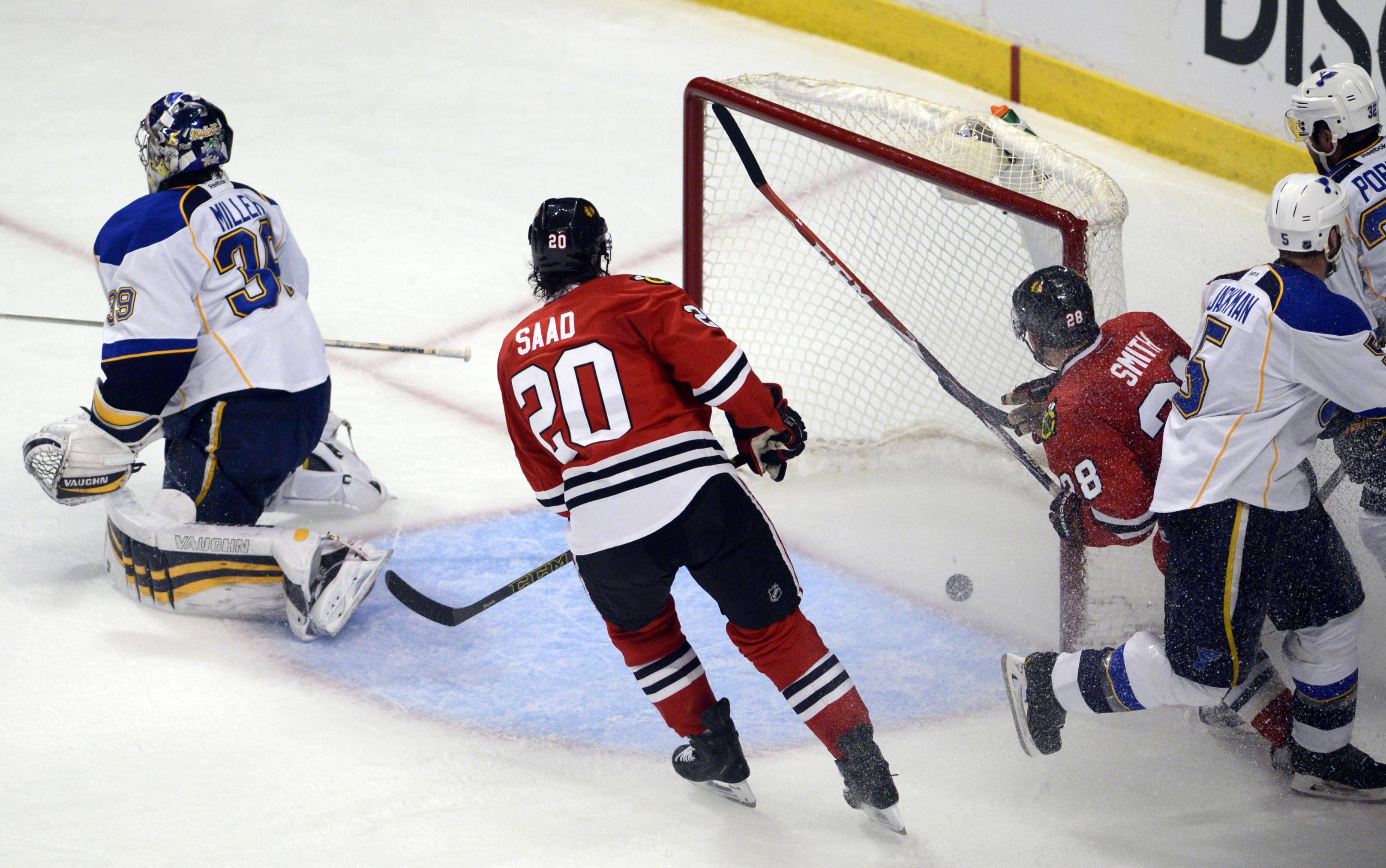 Chicago Blackhawks right wing Ben Smith and Brandon Saad watch Patrick Kane's game-winning goal bounce in the net.