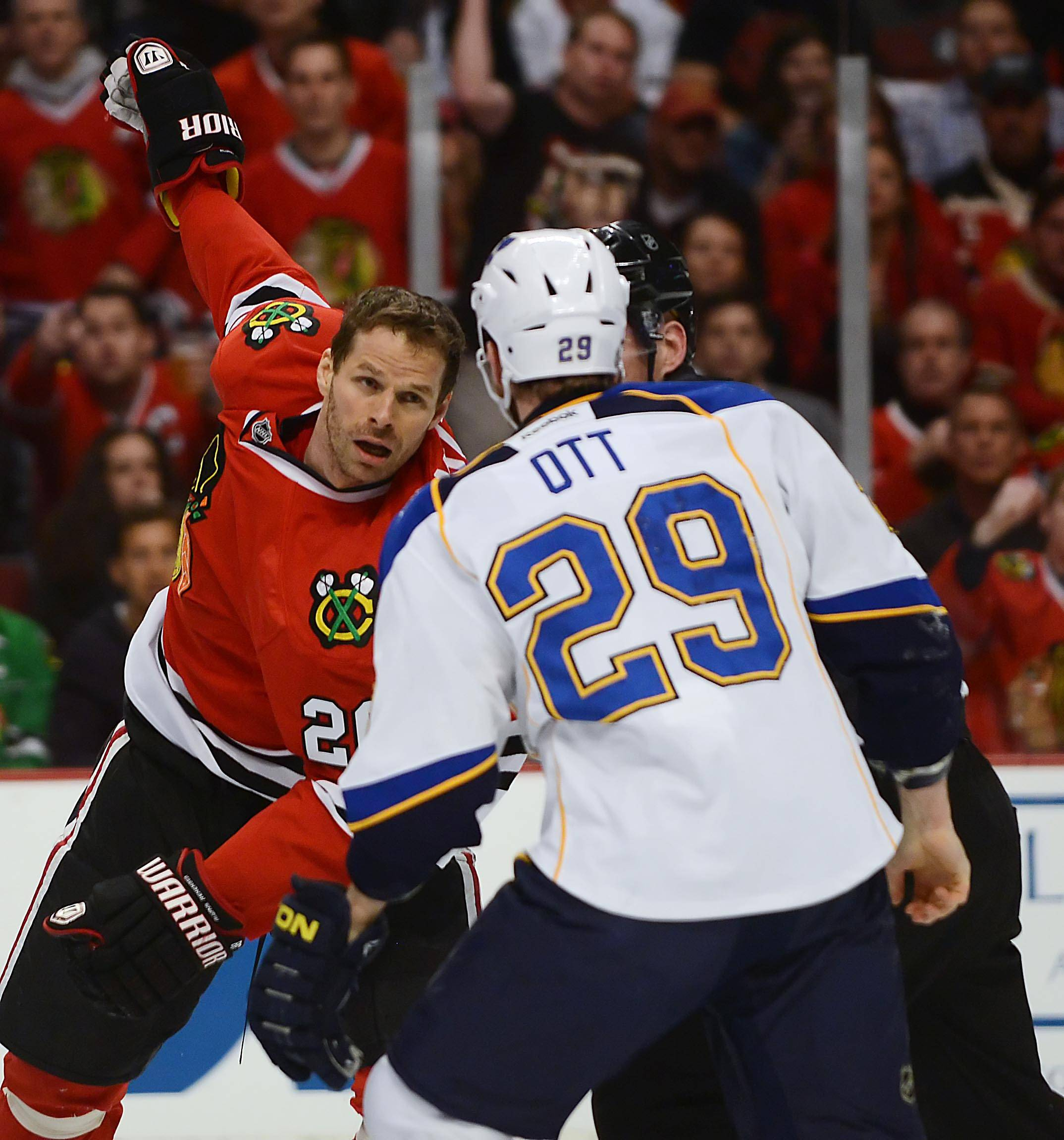 Chicago Blackhawks center Michal Handzus and St. Louis Blues center Steve Ott fight.