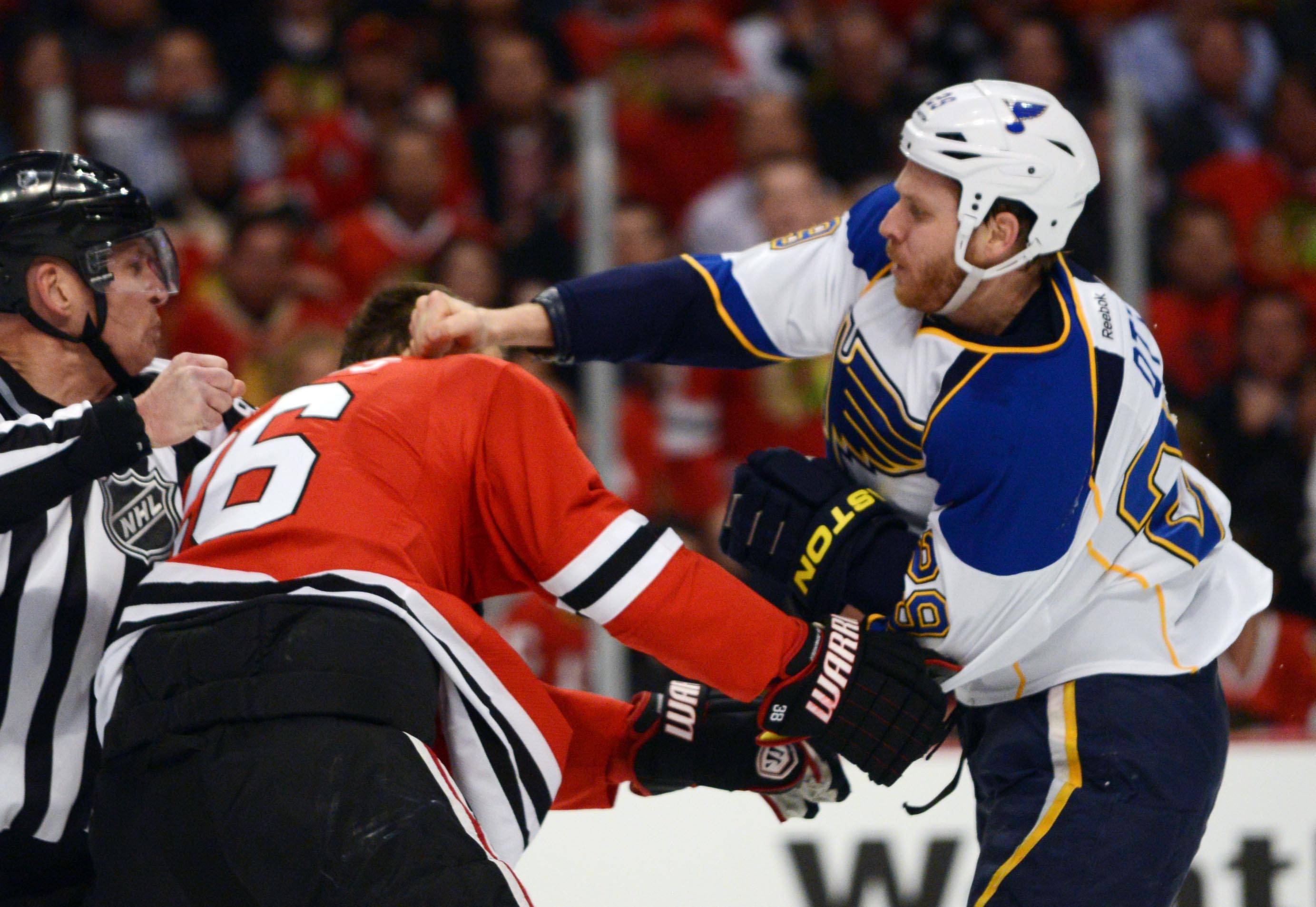 Chicago Blackhawks center Michal Handzus and St. Louis Blues center Steve Ott fight .
