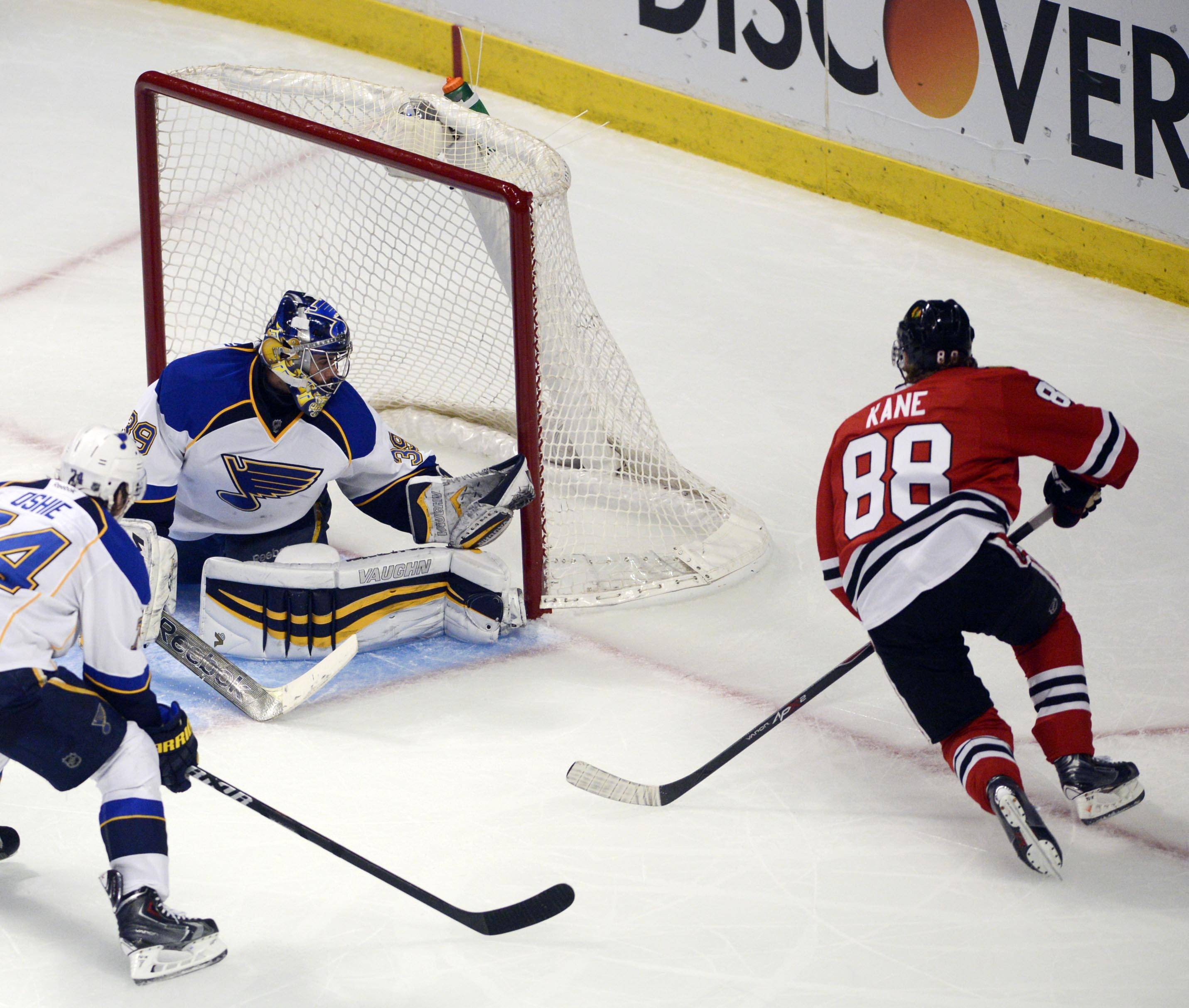 Chicago Blackhawks right wing Patrick Kane scores the second goal of the second period as the puck goes behind St. Louis Blues goalie Ryan Miller.