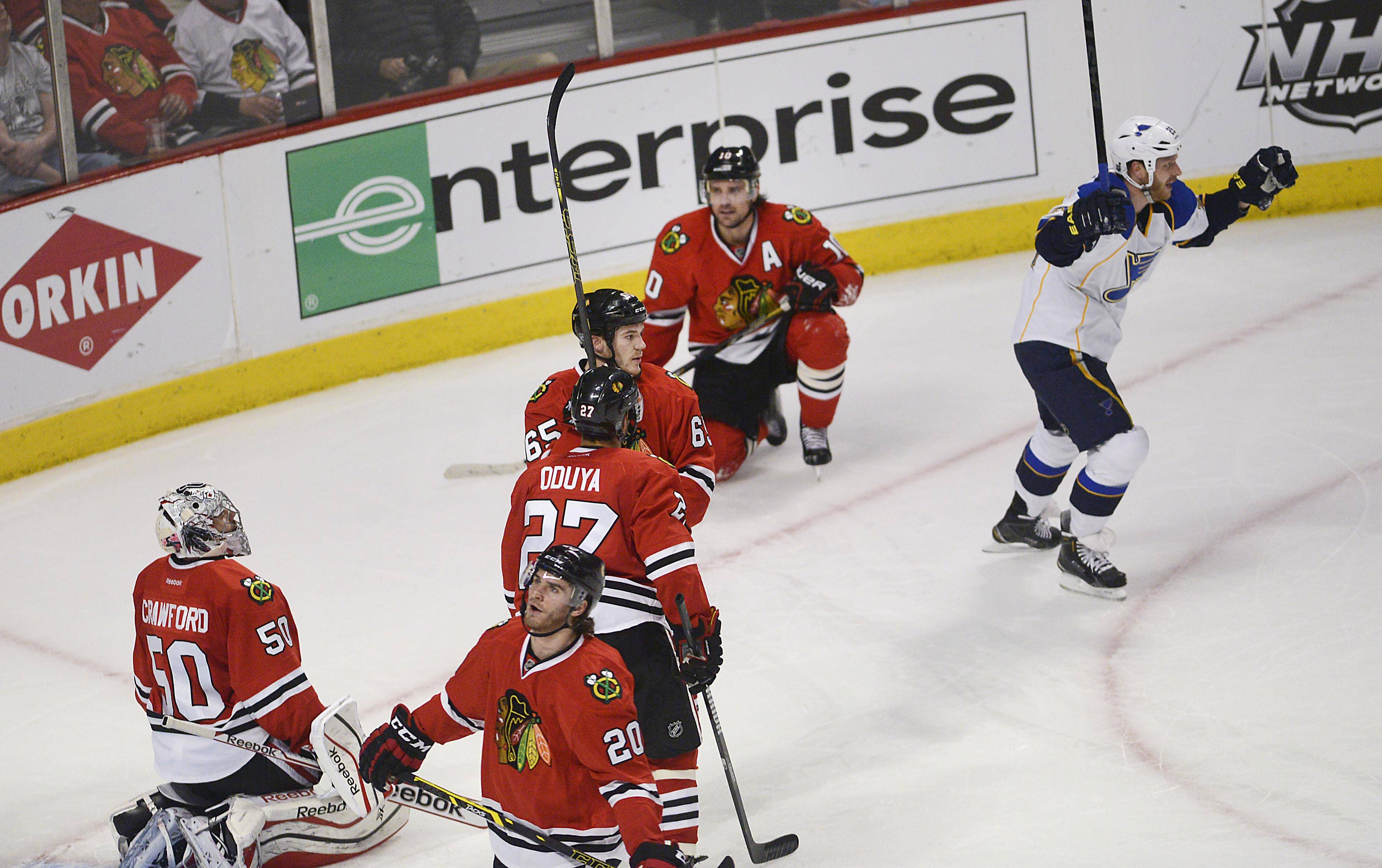 Chicago Blackhawks react as St. Louis Blues defenseman Ian Cole raises his arms as the score is tied late in the second period.
