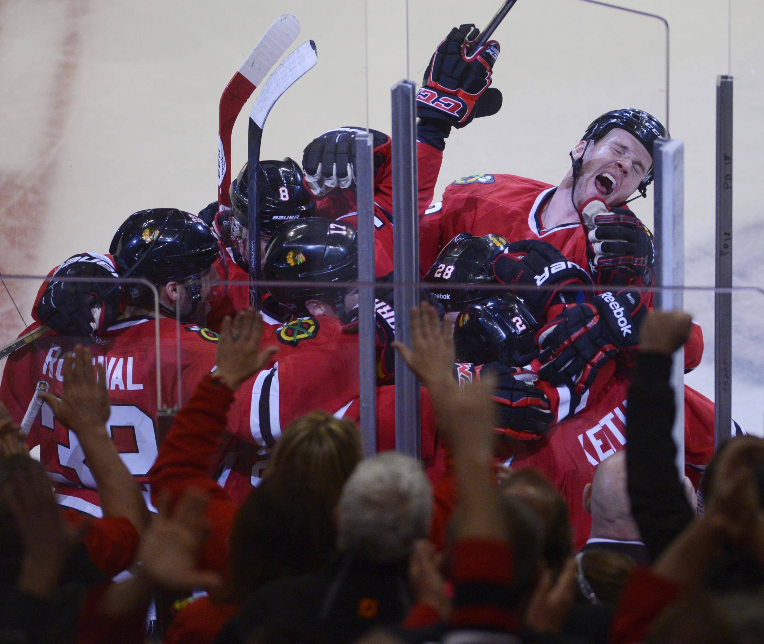 The Blackhawks celebrate Patrick Kane's overtime goal in overtime that evened the series against the St. Louis Blues Wednesday in Game 4 at the United Center in Chicago.