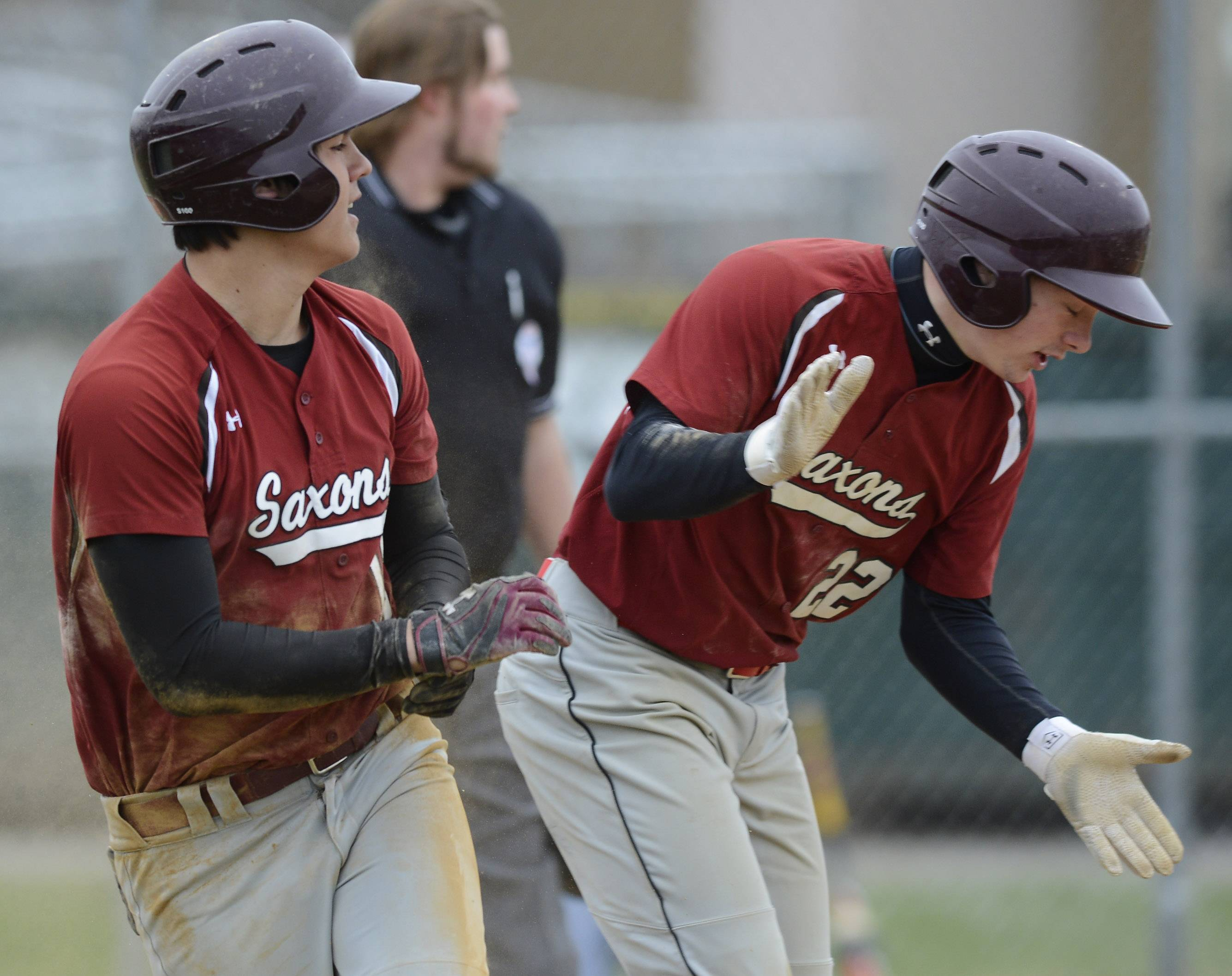 Schaumburg's Michael Fan, left, and Ryan Woloszyk celebrate after they scored to tie the game 2-2 in the bottom of the fourth inning against Conant on Wednesday.