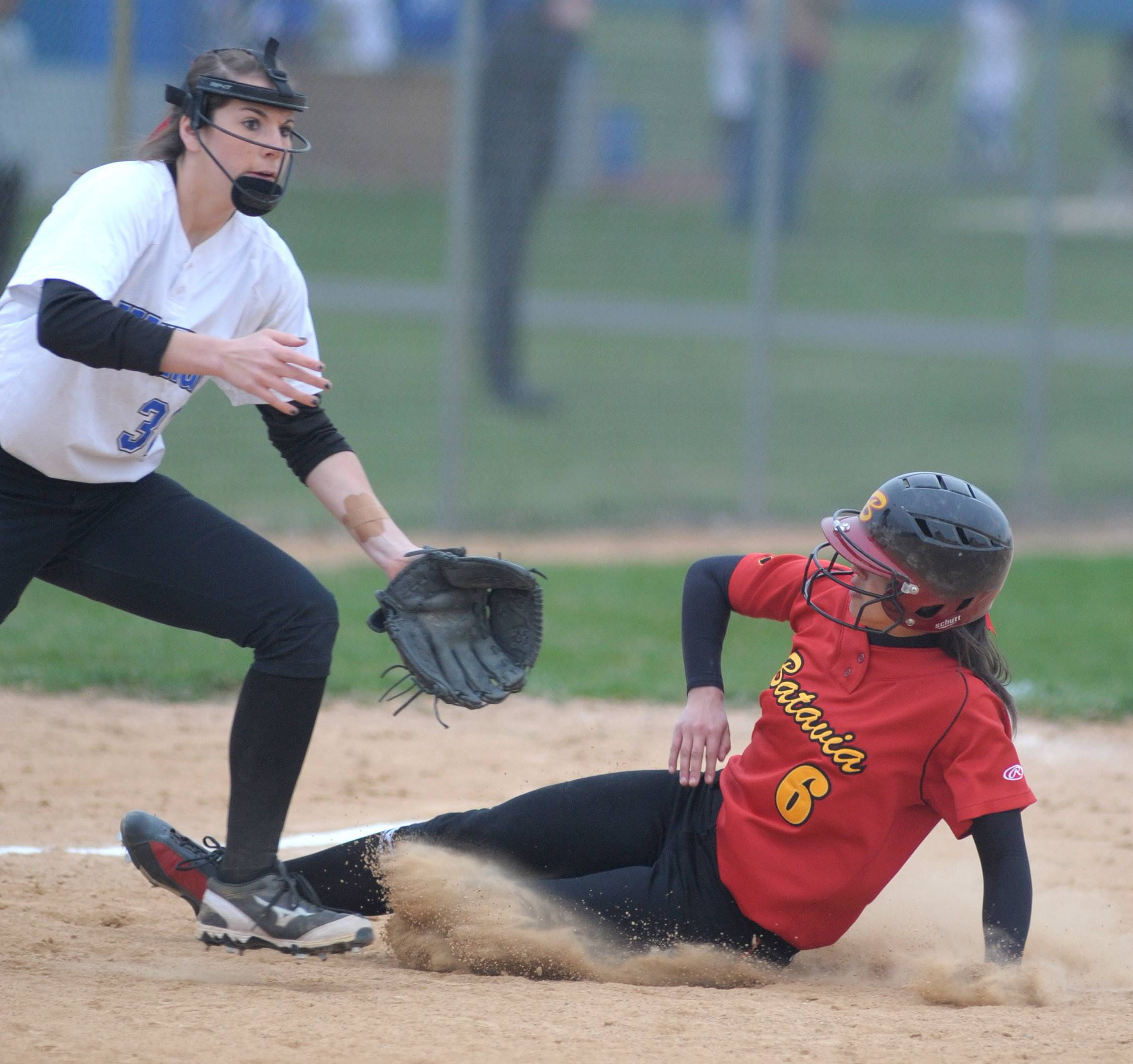 Batavia's Tara Zufan slides safely into third base before the ball hits the mitt of Geneva's Molly Wrenn in the seventh inning on Wednesday, April 23.