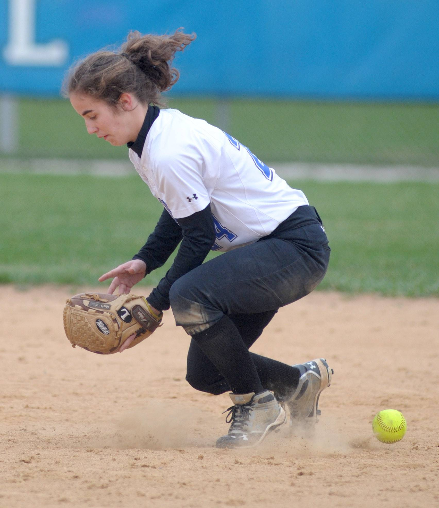 The ball slips between the feet of Jenelle Reilly and past her mitt in the fifth inning vs. Batavia on Wednesday, April 23.