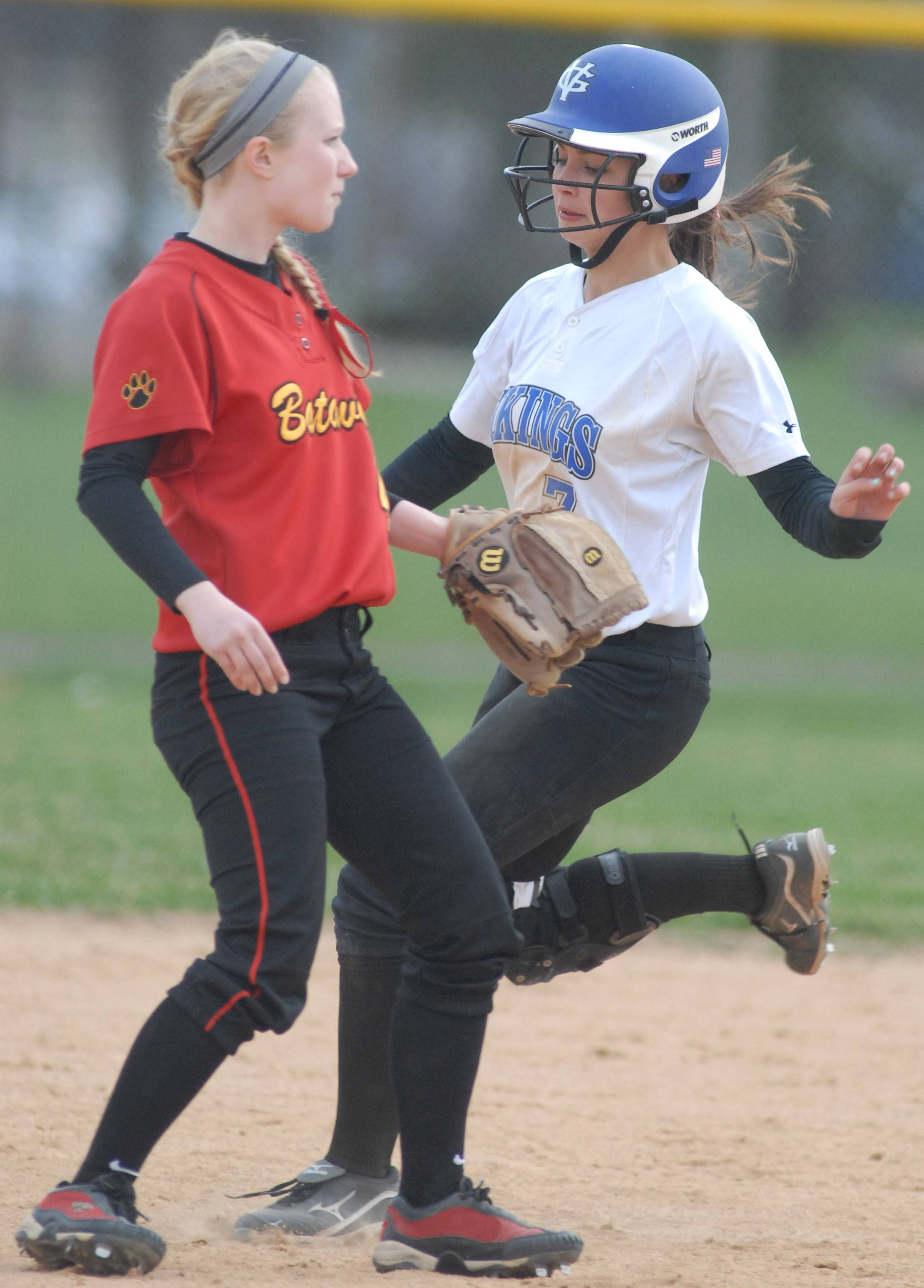 Geneva's Anna Geary is safe on second base from Batavia's Elyse Burns in the first inning on Wednesday, April 23.