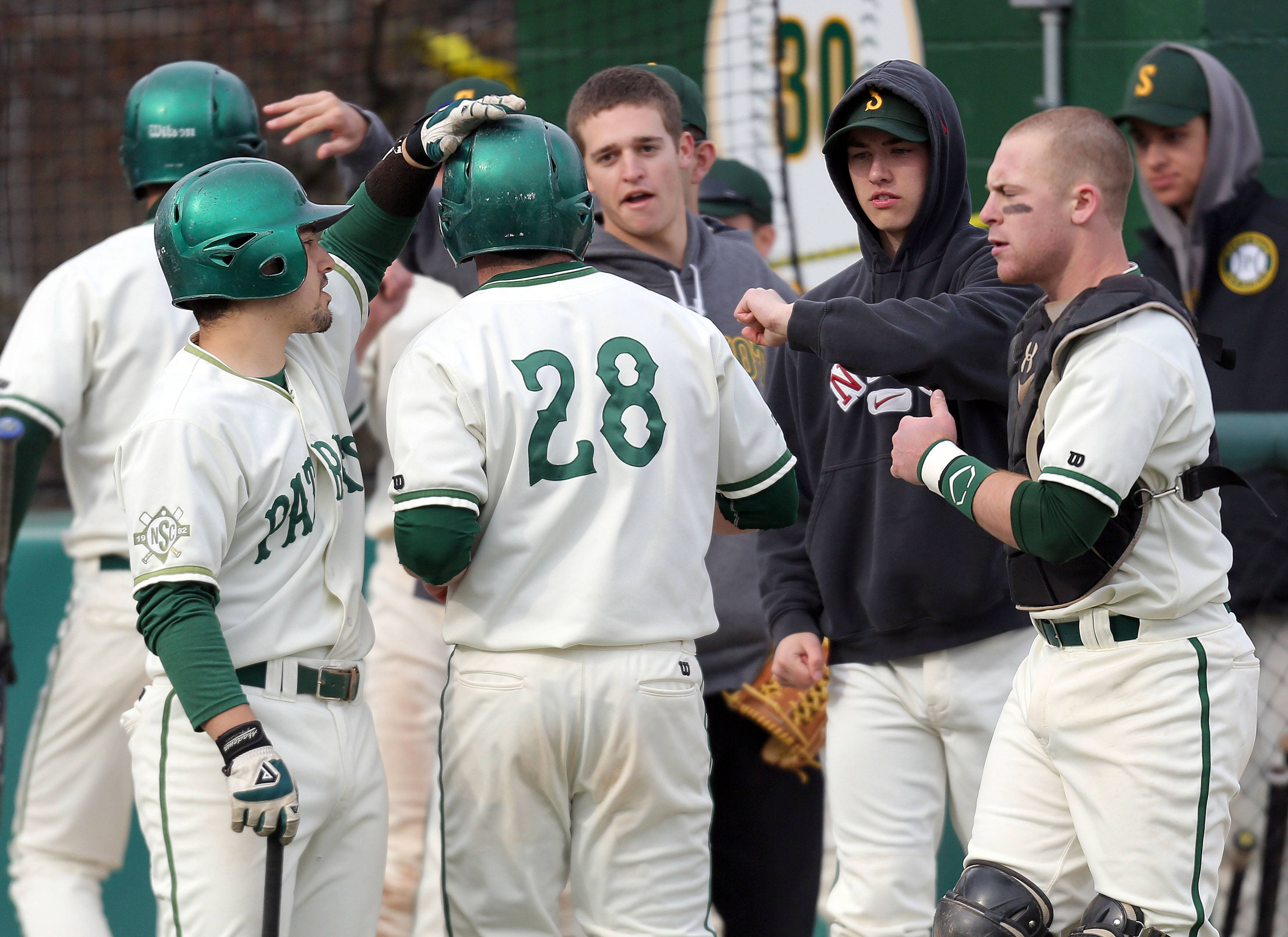 Stevenson's Jack Joseph gets adulation from his teammates after scoring against Warren on Wednesday at Stevenson.
