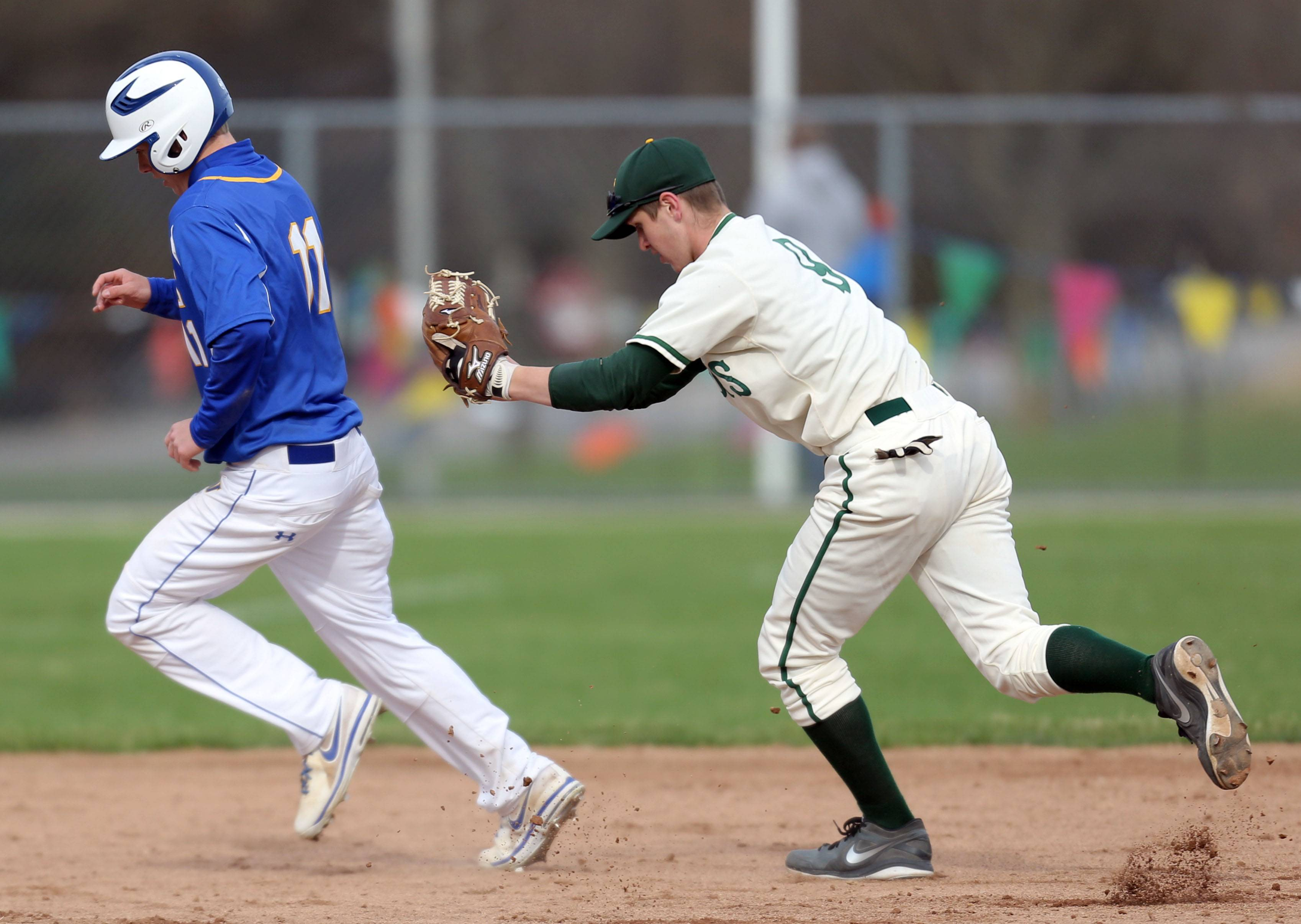 Warren's Chris Mathieu, left, is tagged out in a rundown by Stevenson's Sean Wilson on Wednesday at Stevenson.