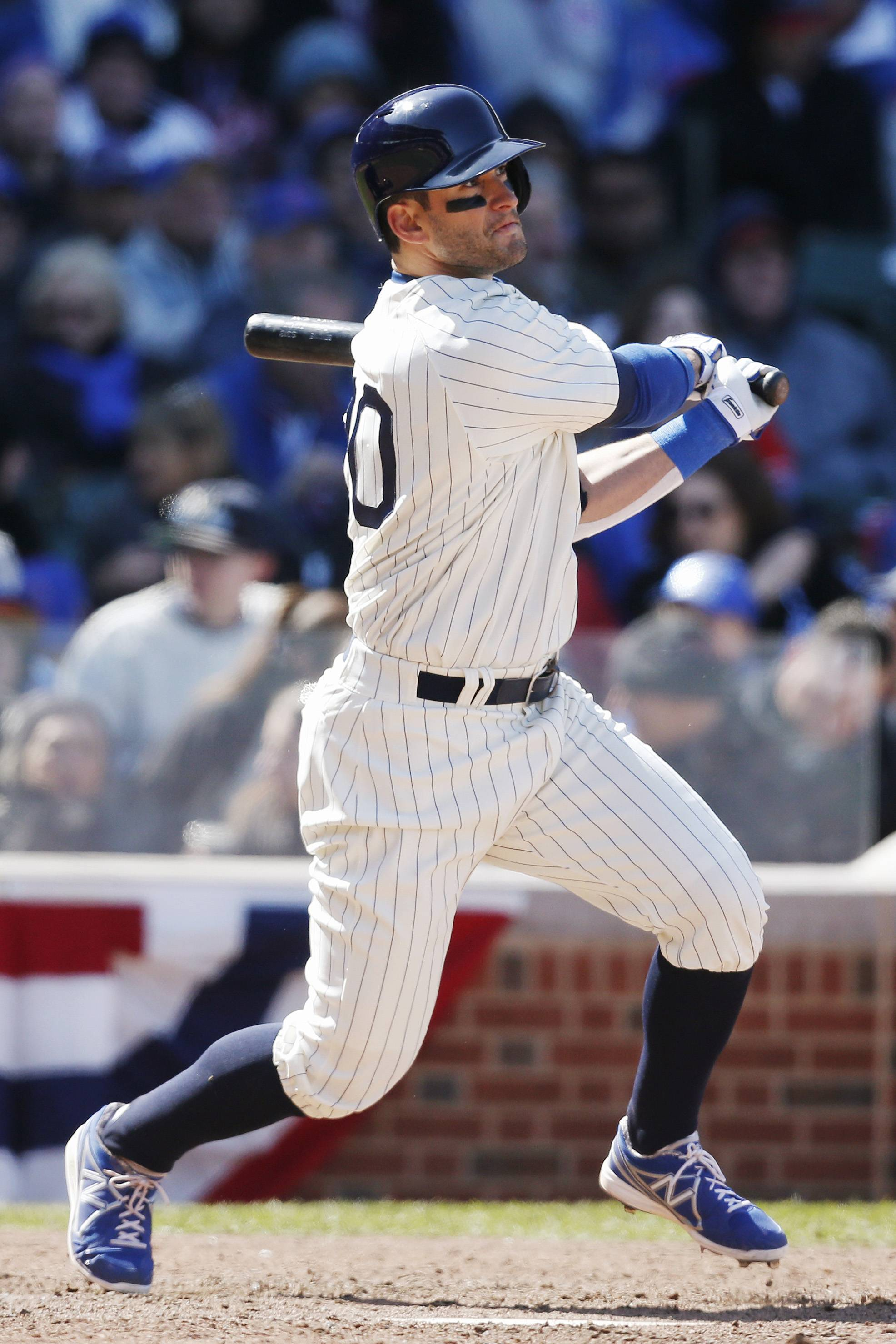 The Cubs Justin Ruggiano watches his two-run homer against the Arizona Diamondbacks during the sixth inning Wednesday at Wrigley Field. The Cubs lost to the Diamondbacks 7-5 on Wrigley Field's 100th anniversary.