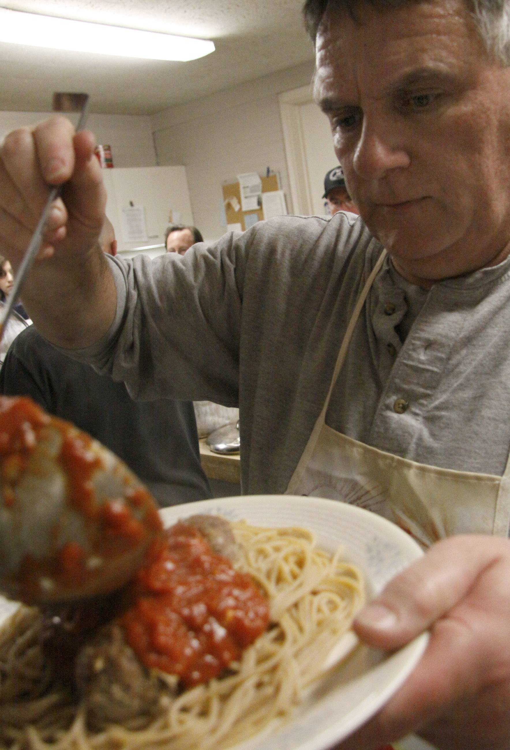 Since 2009, St. Charles Episcopal Church member Joe Ryan, pictured, and Matt Rhead have hosted Two Guys and Free Spaghetti, a free dinner to anyone in the community.