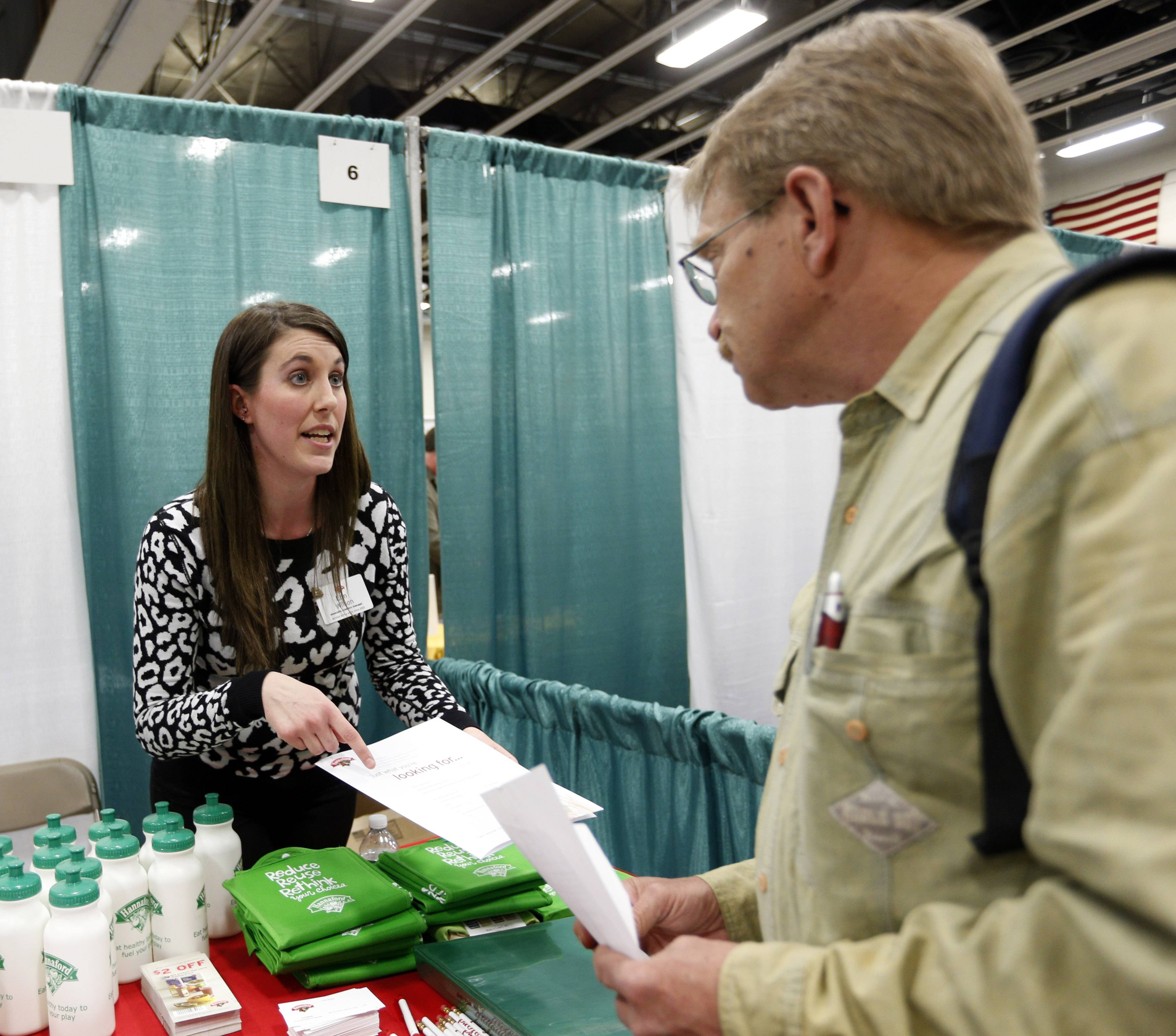 Erin Wilson, of Hannaford Bros. supermarket company, left, talks with a job seeker during a job fair Columbia-Greene Community College in Hudson, N.Y.