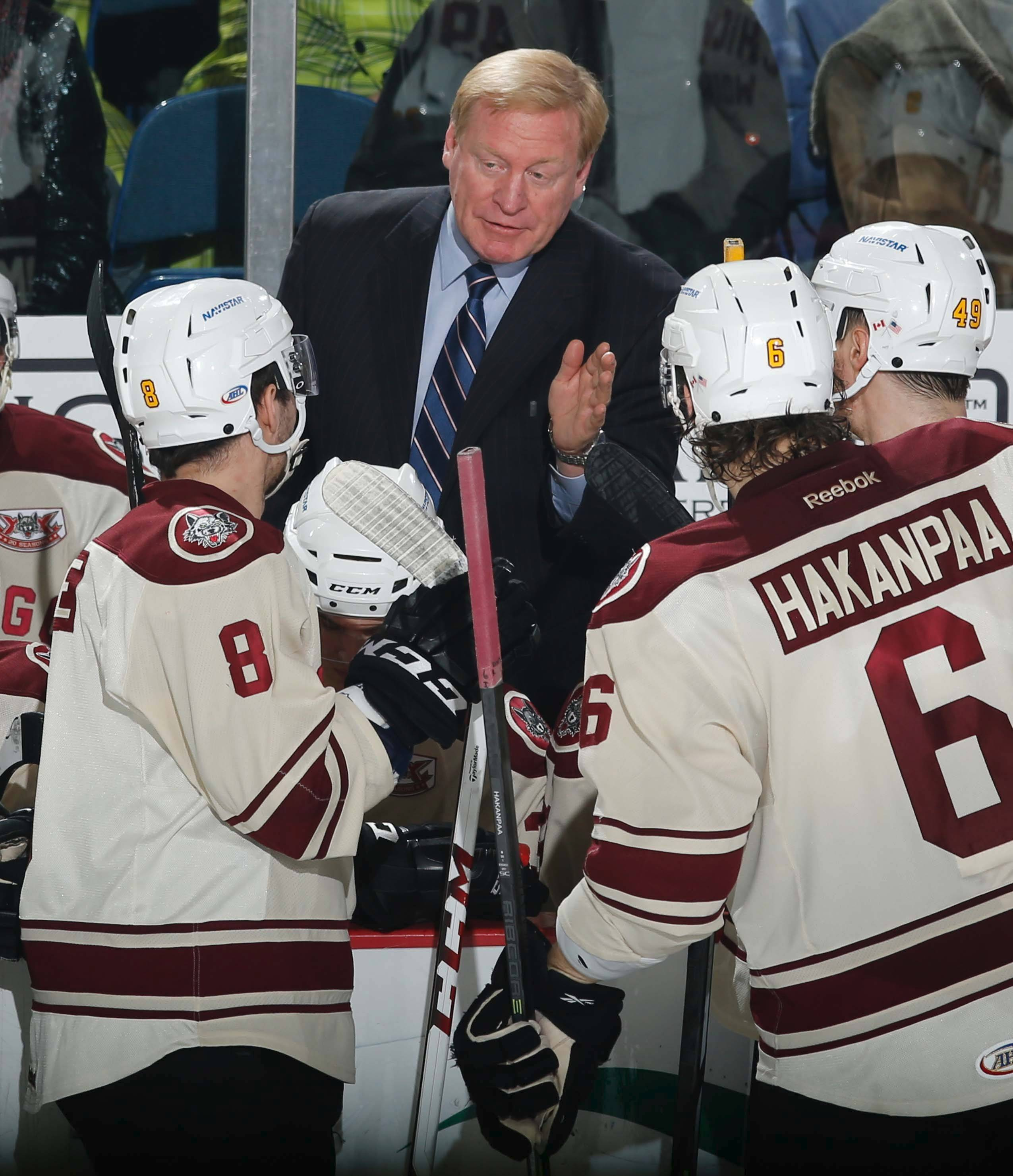 Wolves head coach John Anderson, here giving instructions to Ty Rattie (8), Jani Hakanpaa and Alex Bolduc (49), has collected 105 playoff wins in his 12 seasons with the Chicago Wolves.