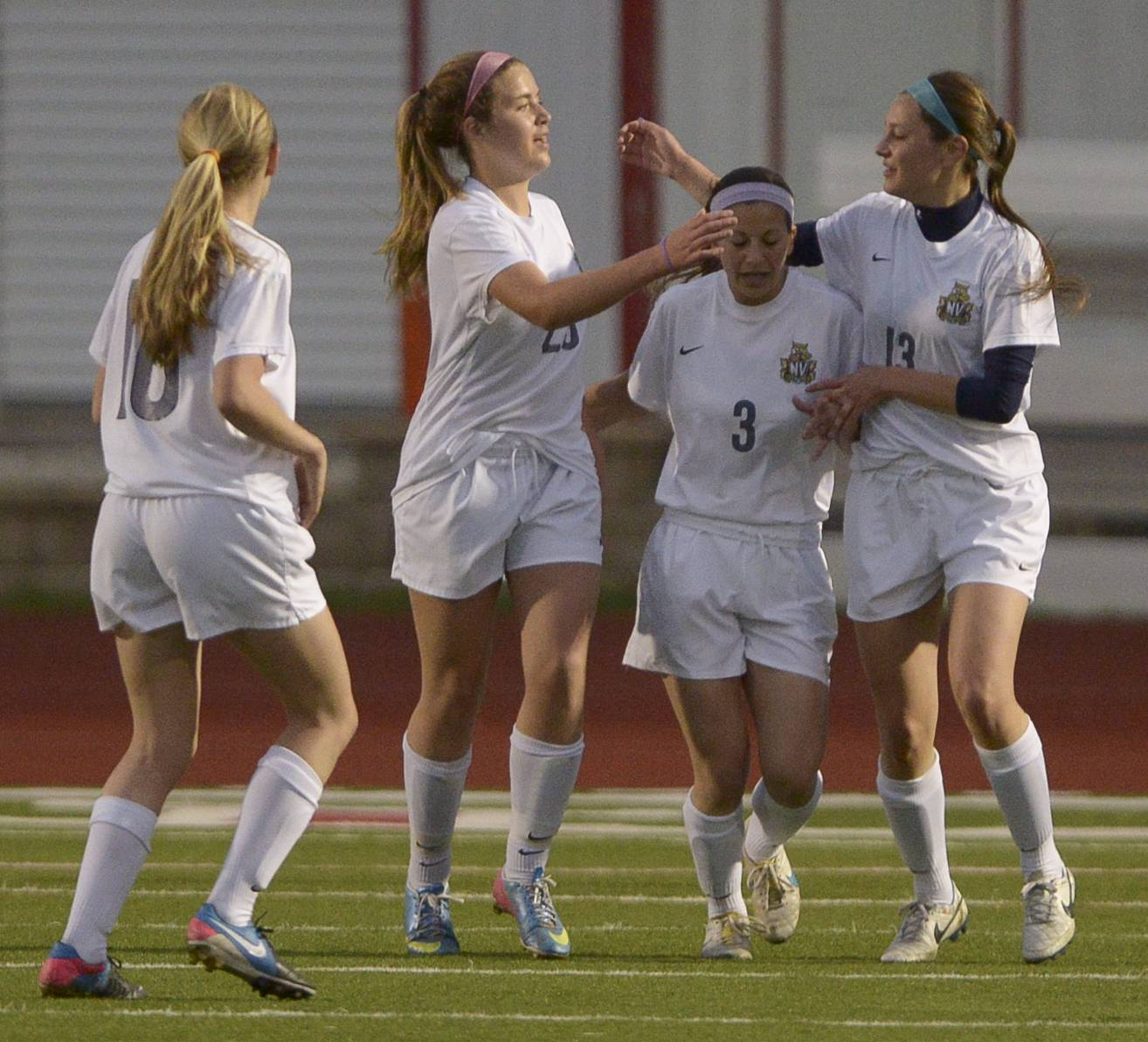 Neuqua Valley's Allie Fullreide (23) is congratulated by teammates after scoring a goal during the 2014 Naperville girls soccer invitational Thursday.