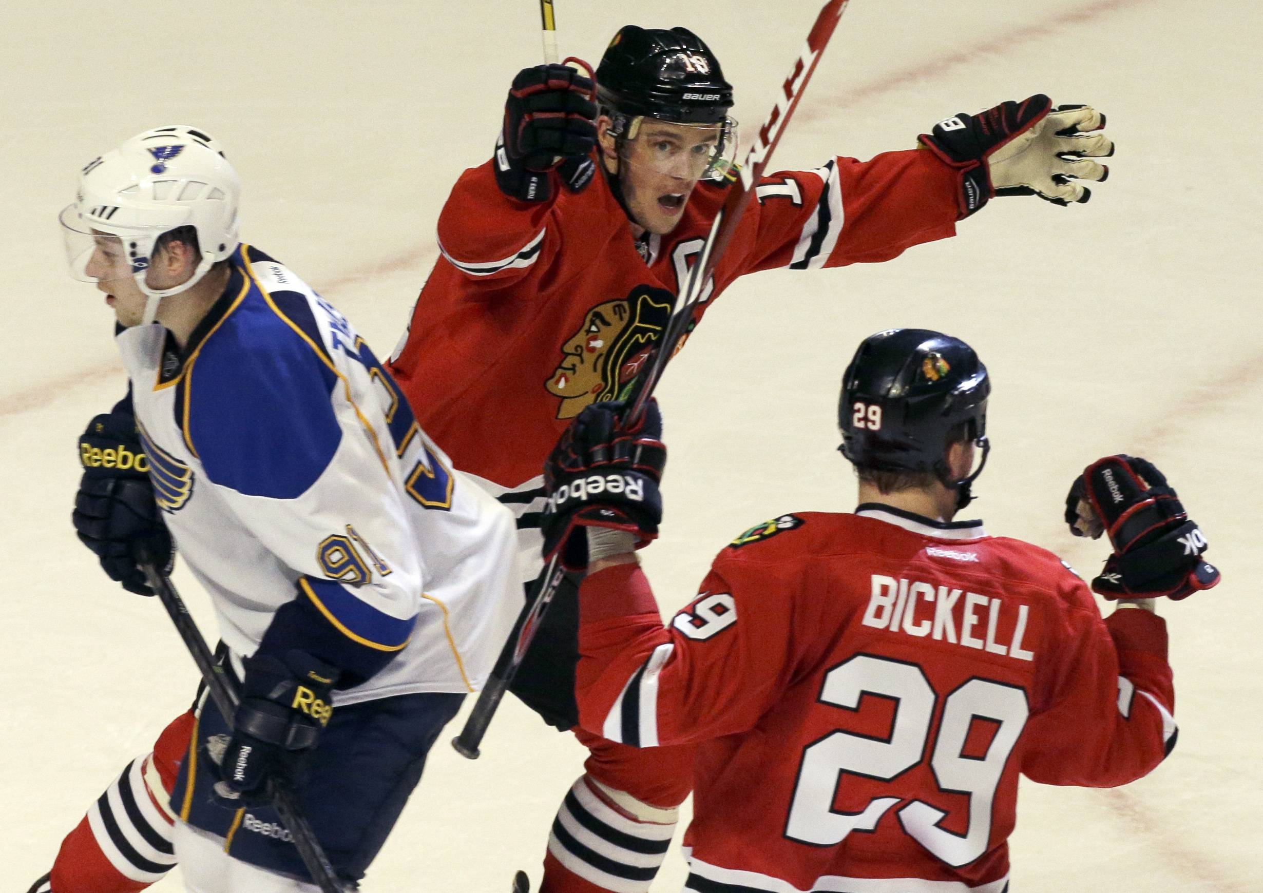 Jonathan Toews celebrates after Bryan Bickell's game-tying goal against the Blues late in the third period Wednesday at the United Center.