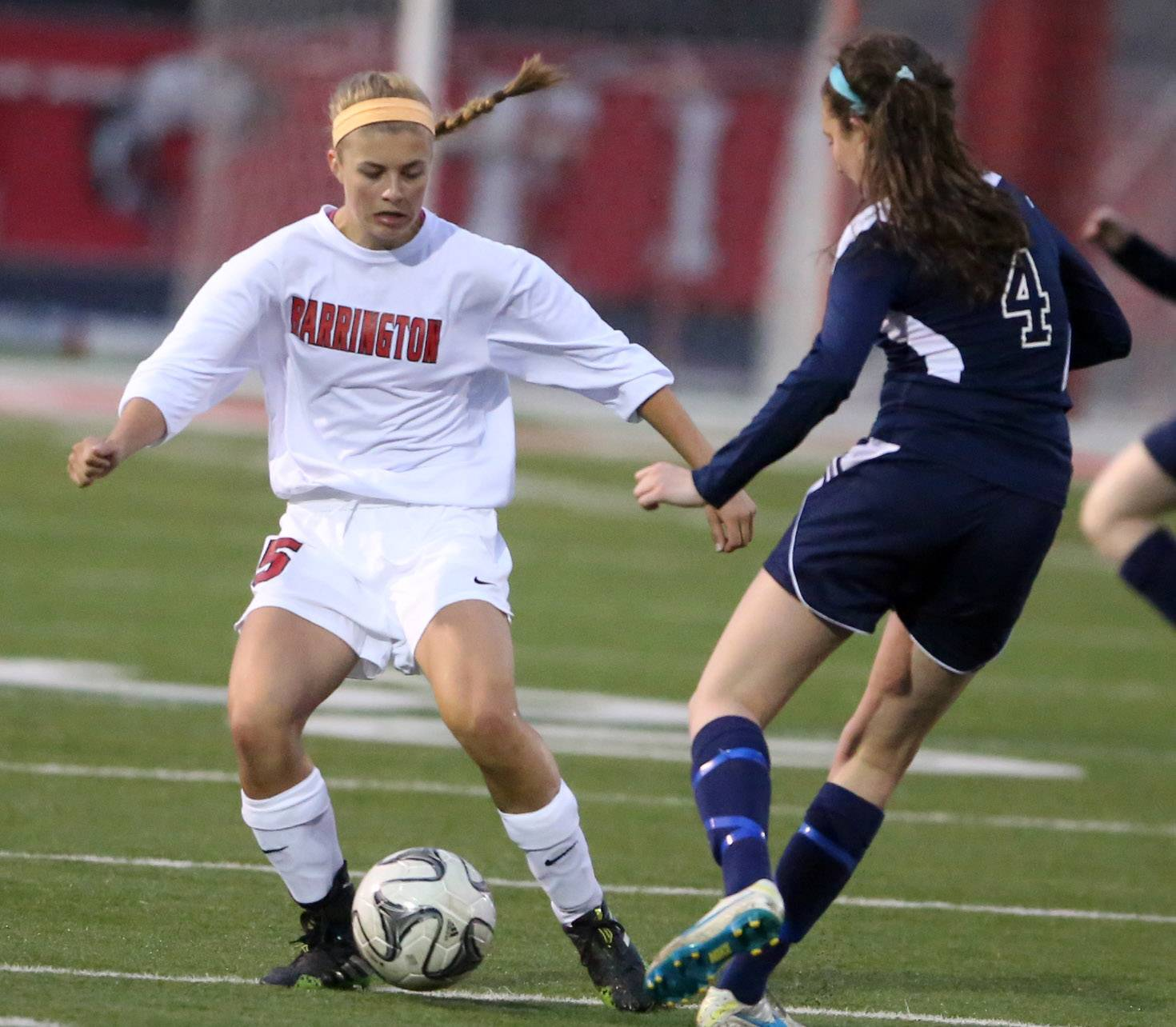 Barrington's Jackie Batliner, left, looks to dibble past St. Viator's Susie Moynihan on Thursday in Barrington.