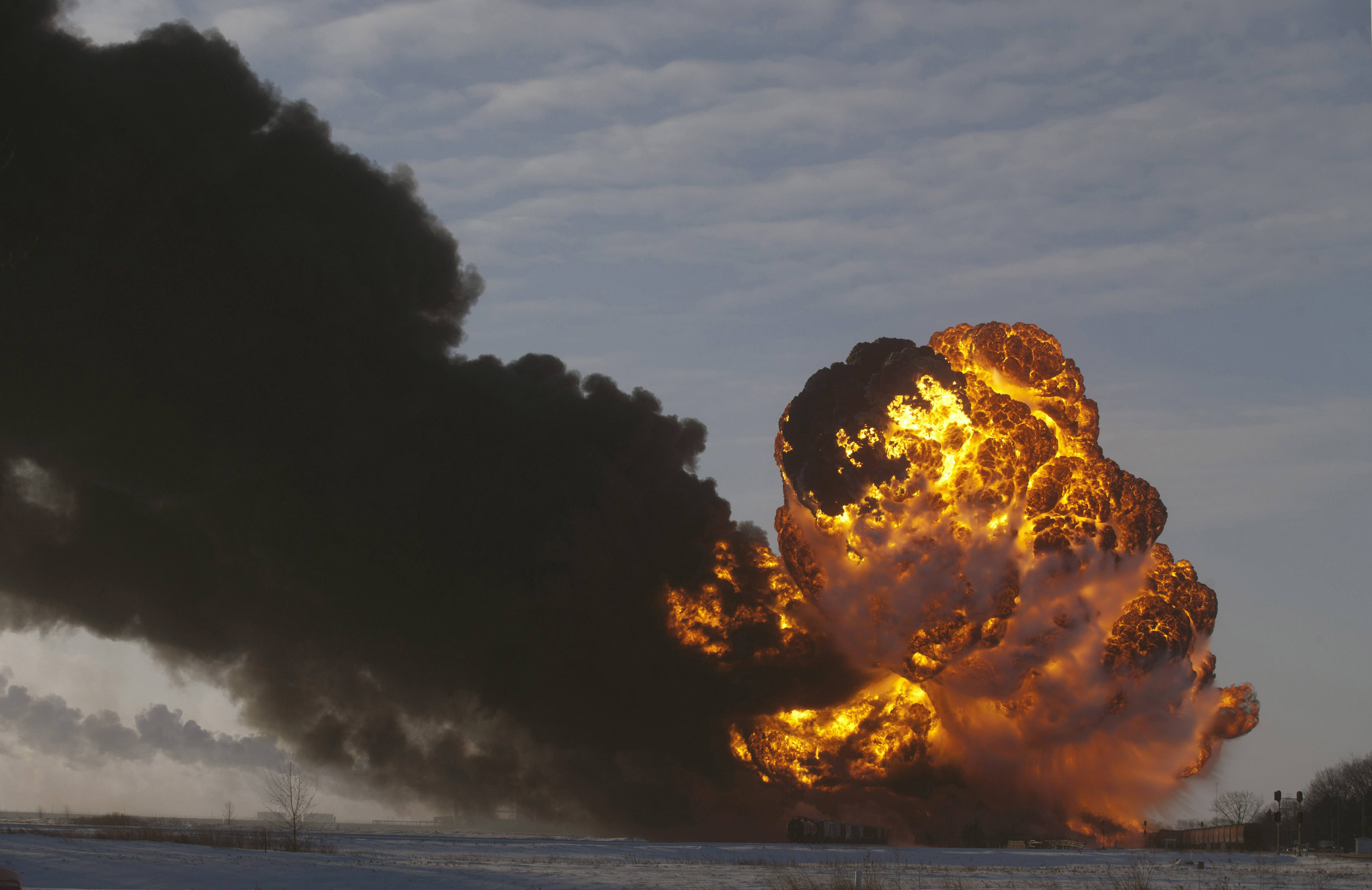 This Dec. 30, 2013 photo shows a fireball going up at the site of an oil train derailment in Casselton, N.D.  Spurred by a series of fiery train crashes, a push by government and industry to make safer tank cars used for shipping crude oil and ethanol has bogged down in squabbling and finger-pointing over whether they're needed and if so, who should pay.