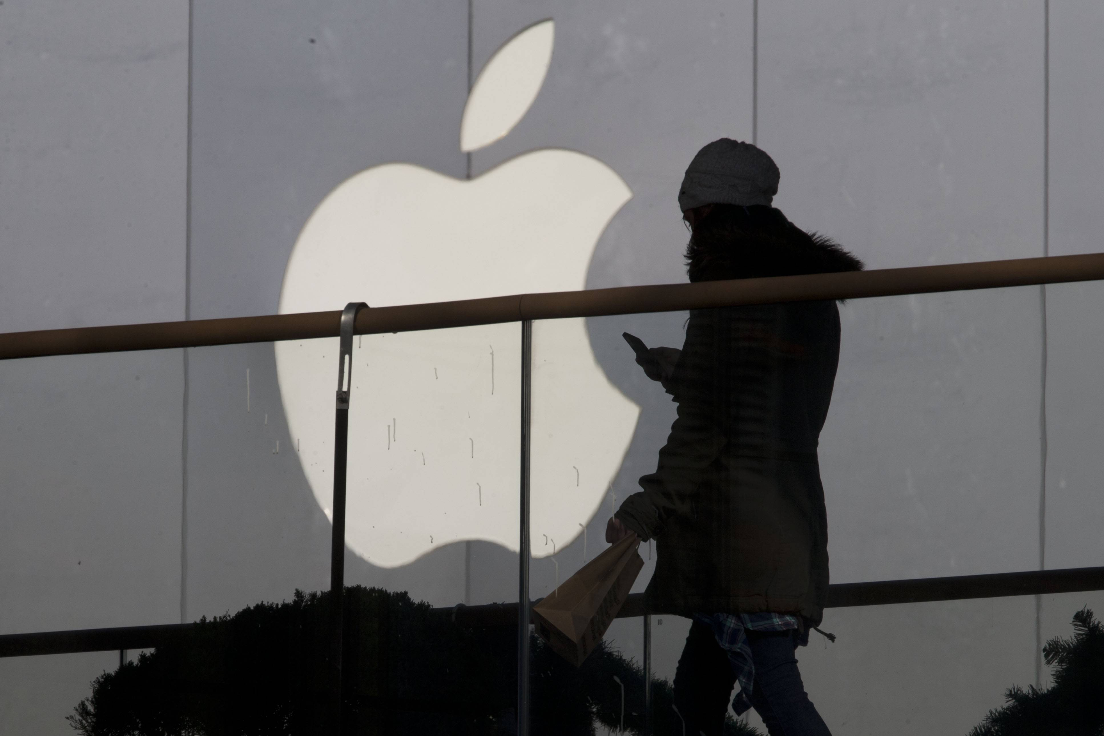 Apple plans to buy back an additional $30 billion of its stock, raise its quarterly dividend by 8 percent and split its stock for the first time in nine years.