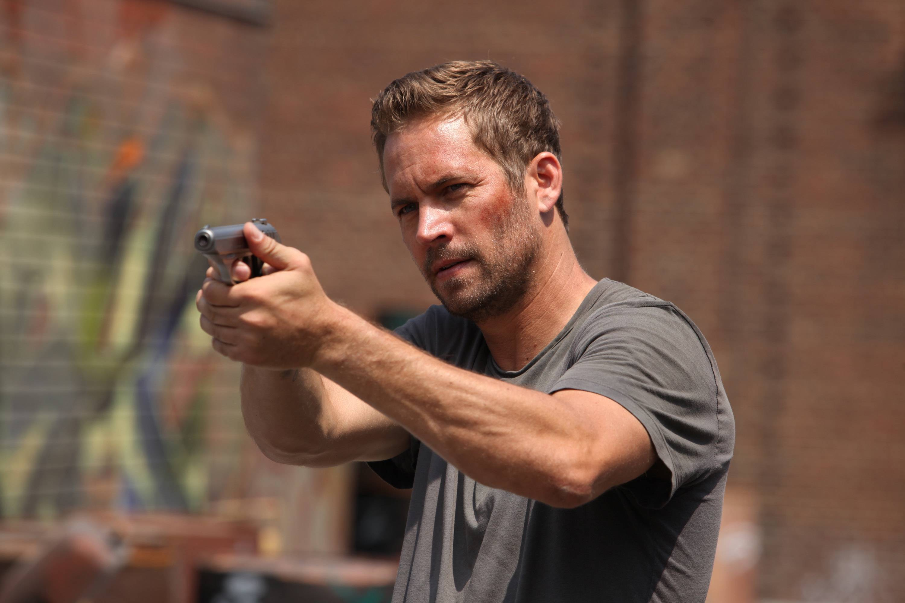 "An undercover cop (Paul Walker) goes on a mission to save 2018 Detroit in ""Brick Mansions."""