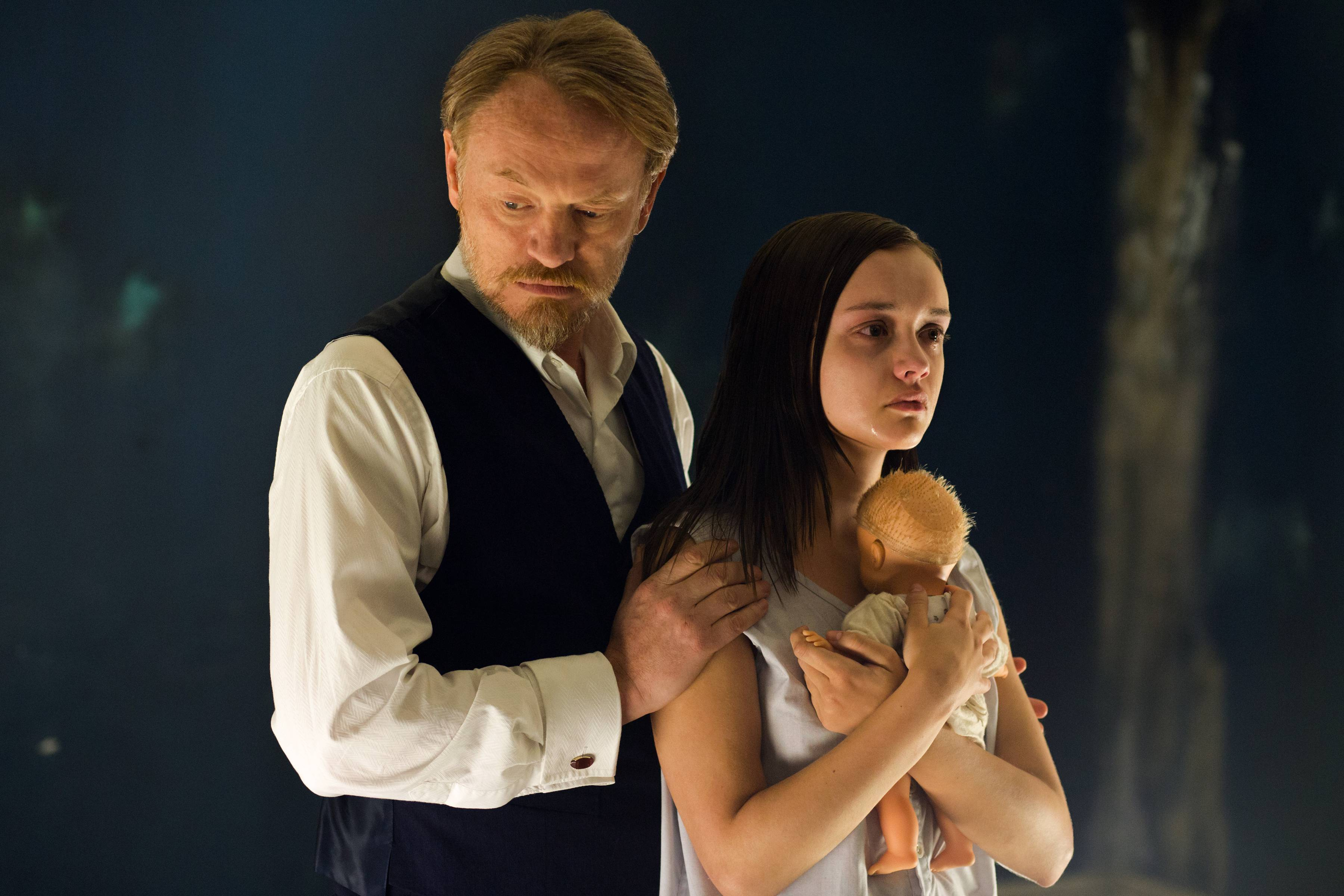 "Psychology professor Joseph Coupland (Jared Harris) turns to unorthodox methods to treat unstable Jane Harper (Olivia Cooke) in ""The Quiet Ones."""