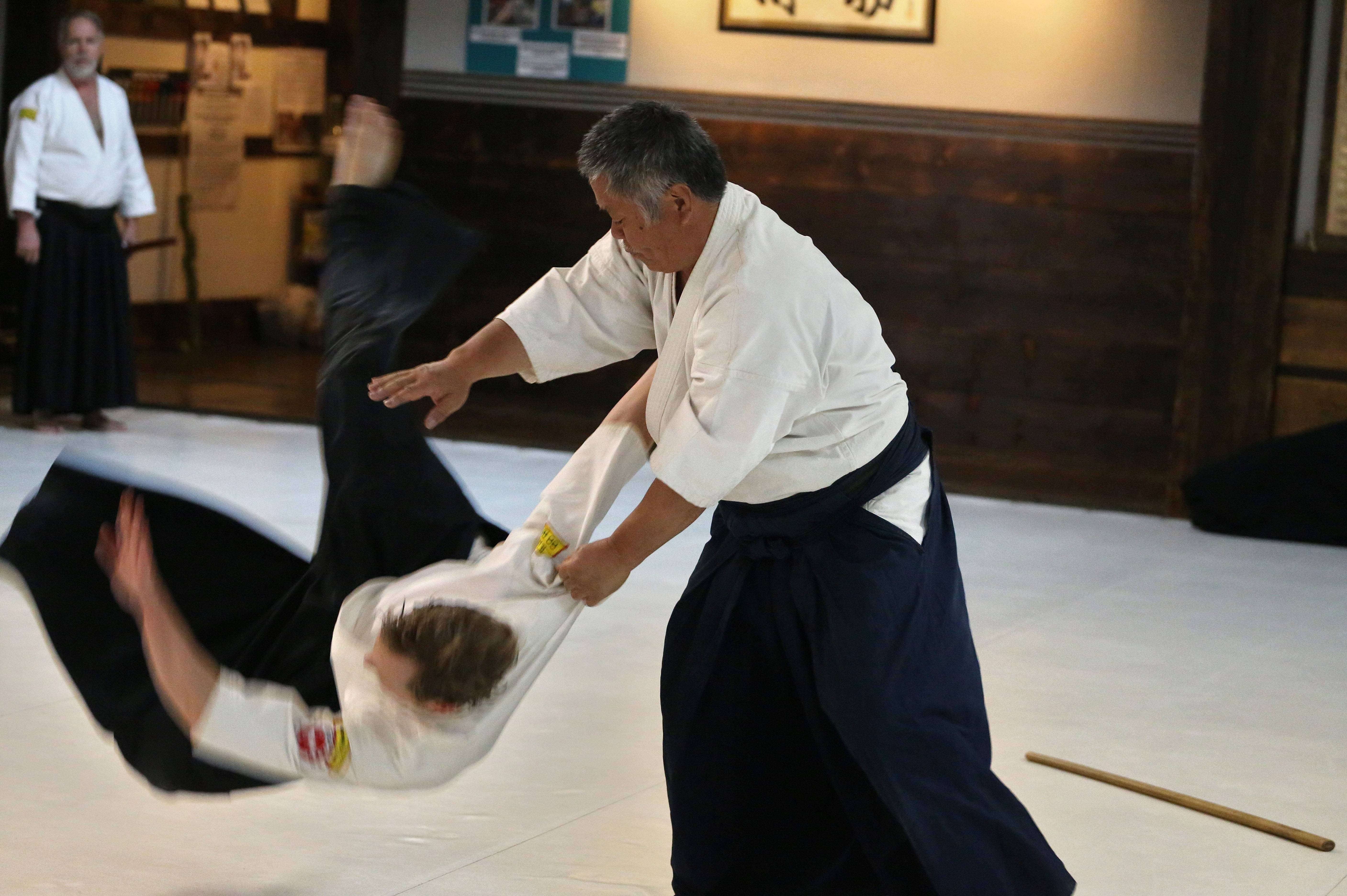 Domo owner and Aikido instructor Gaku Homma Sensei flips an advanced Aikido student during a seniors class he teaches at his Aikido center, adjacent to his restaurant in Denver. Homma has shaped Domo into a place where you can immerse yourself in Japanese culture, by visiting a museum that evokes a northern Japanese farmhouse, strolling in a garden studded with Buddha statues or even taking a martial arts class in the converted former warehouse where the restaurant compound is located.