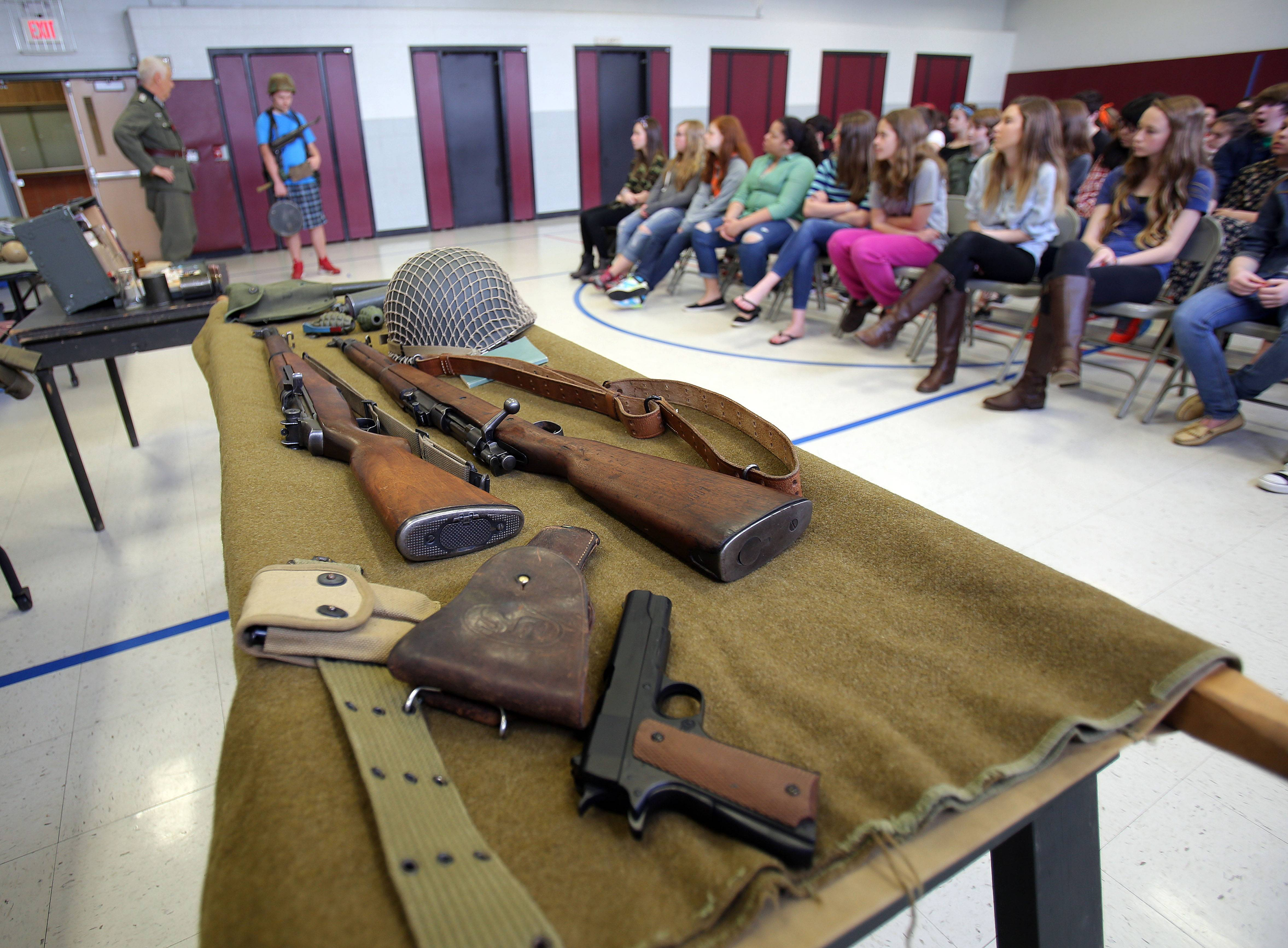 World War II re-enactors visit Fremont Middle School in Mundelein on Thursday to talk about what it was like to be a soldier or a pilot.