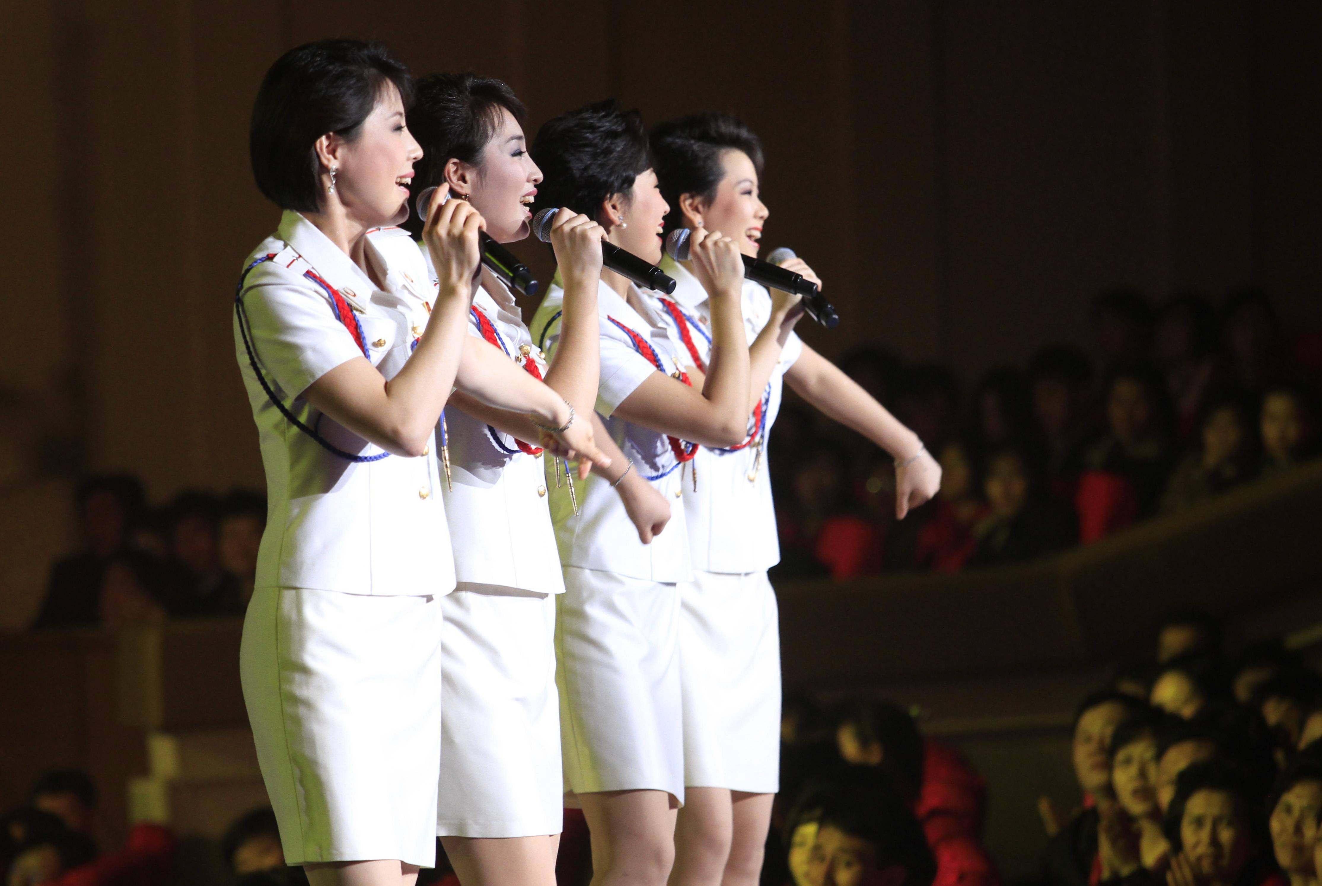 Singers of the Moranbong Band perform in Pyongyang, North Korea, March 28. Kim Jong Un's favorite guitar-slinging, miniskirt-sporting girl group, the Moranbong Band, is back.
