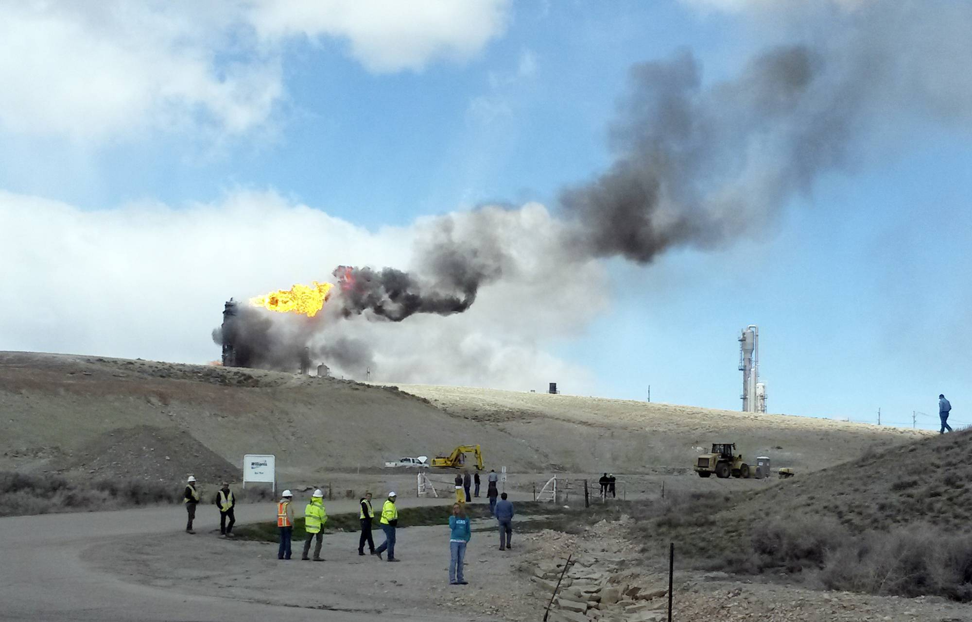 The site of an explosion and fire at a natural gas processing facility and major national pipeline hub, Wednesday, April 23, 2014, in Opal, Wyo. Officials said there are no reports of injuries and the residents of Opal have been evacuated to an area about 3 miles outside the town as a precaution. Opal has about 95 residents and is about 100 miles northeast of Salt Lake City.