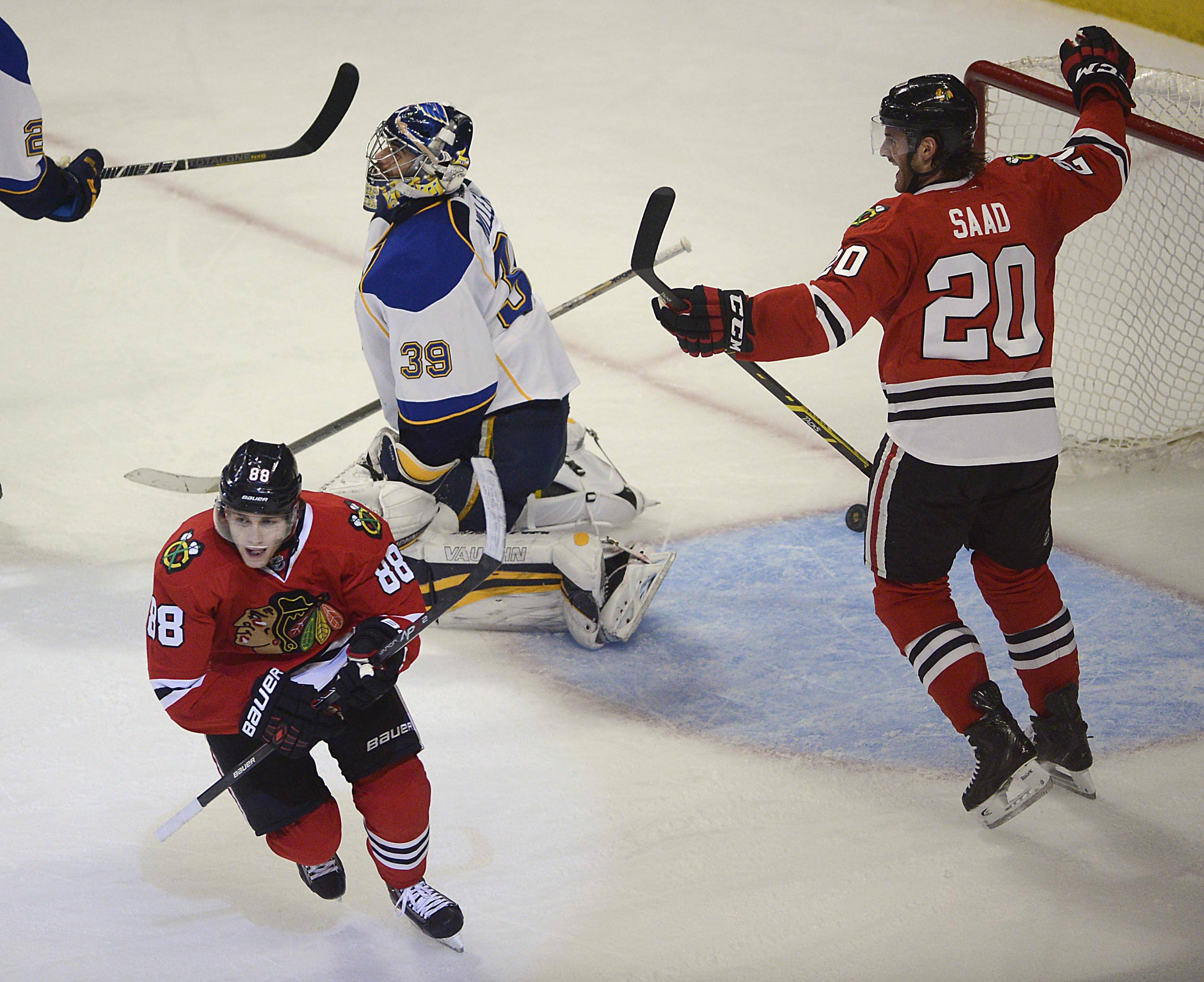 Blackhawks right wing Patrick Kane, left, skates away from his game-winning overtime goal against the St. Louis Blues in Game 4 of their first-round playoff series late Wednesday at the United Center.
